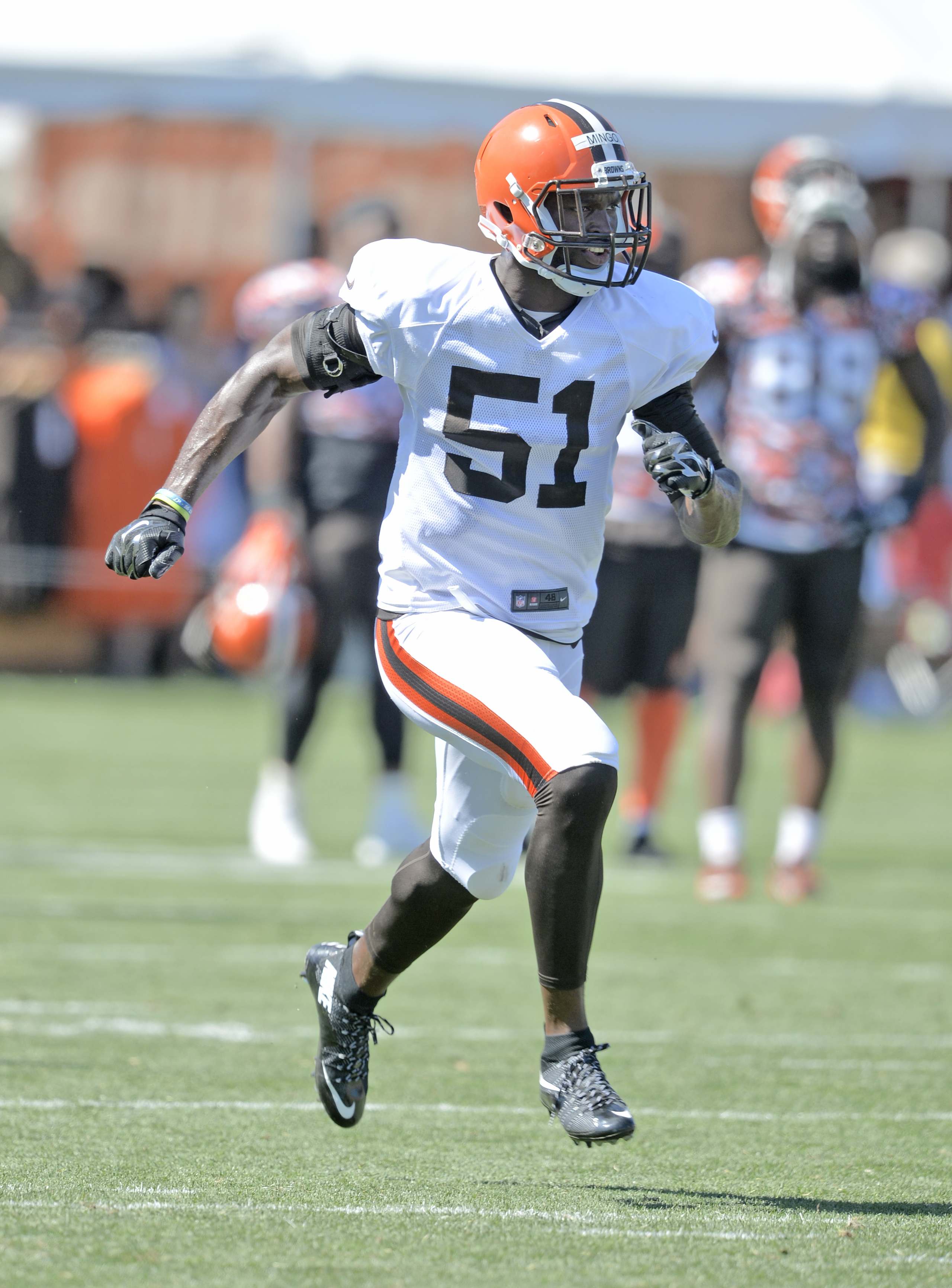FILE - In this Aug. 4, 2015, file photo, Cleveland Browns outside linebacker Barkevious Mingo runs on the field during practice at NFL football training camp in Berea, Ohio. Browns linebacker Barkevious Mingo will undergo arthroscopic surgery on his right