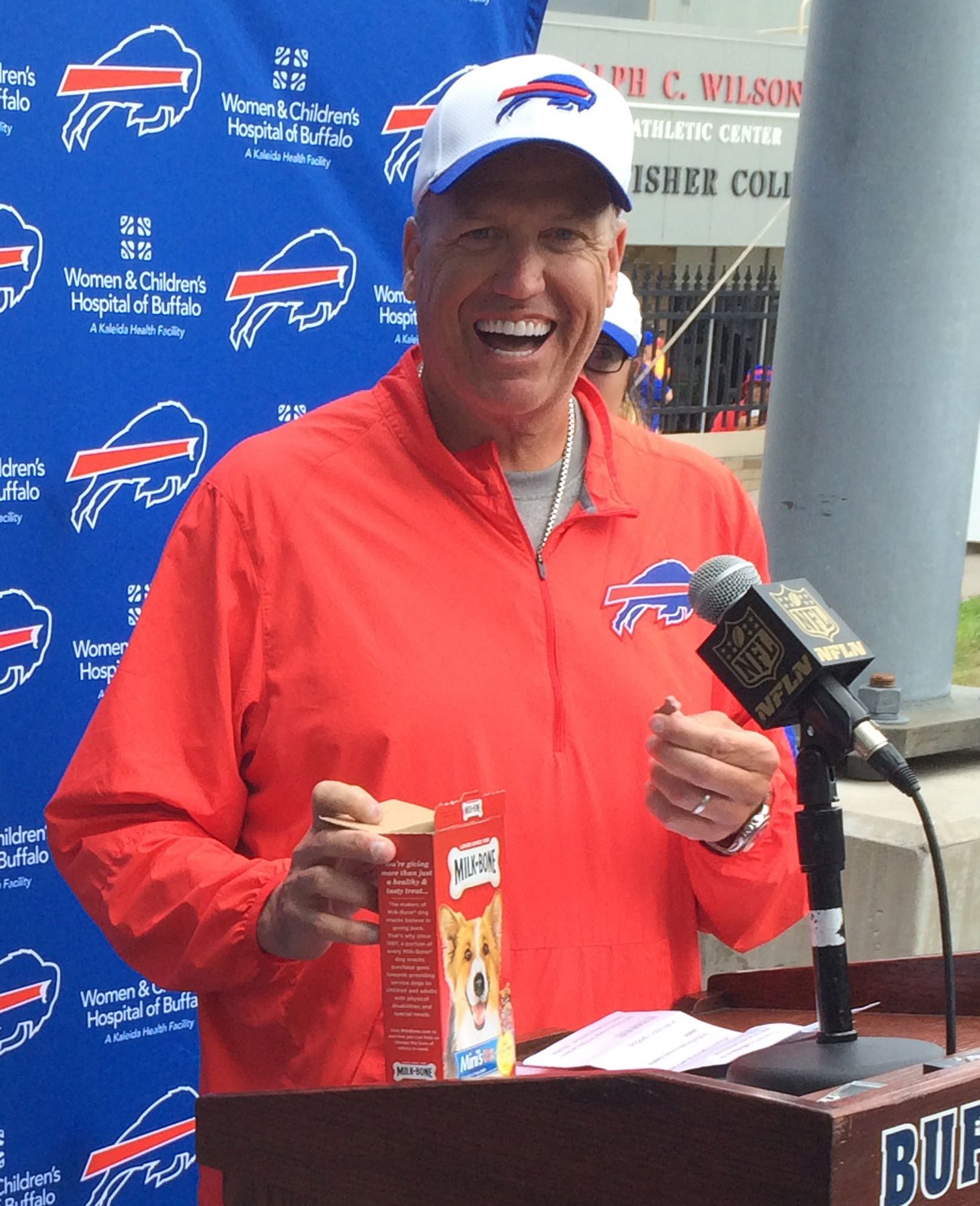 Buffalo Bills head coach Rex Ryan smiles as he delivers on a challenge by eating two dog biscuits following practice at the team's training camp facility in Pittsford, N.Y., Thursday, Aug. 6, 2015. Ryan then challenged Bills owner Terry Pegula, who ate on