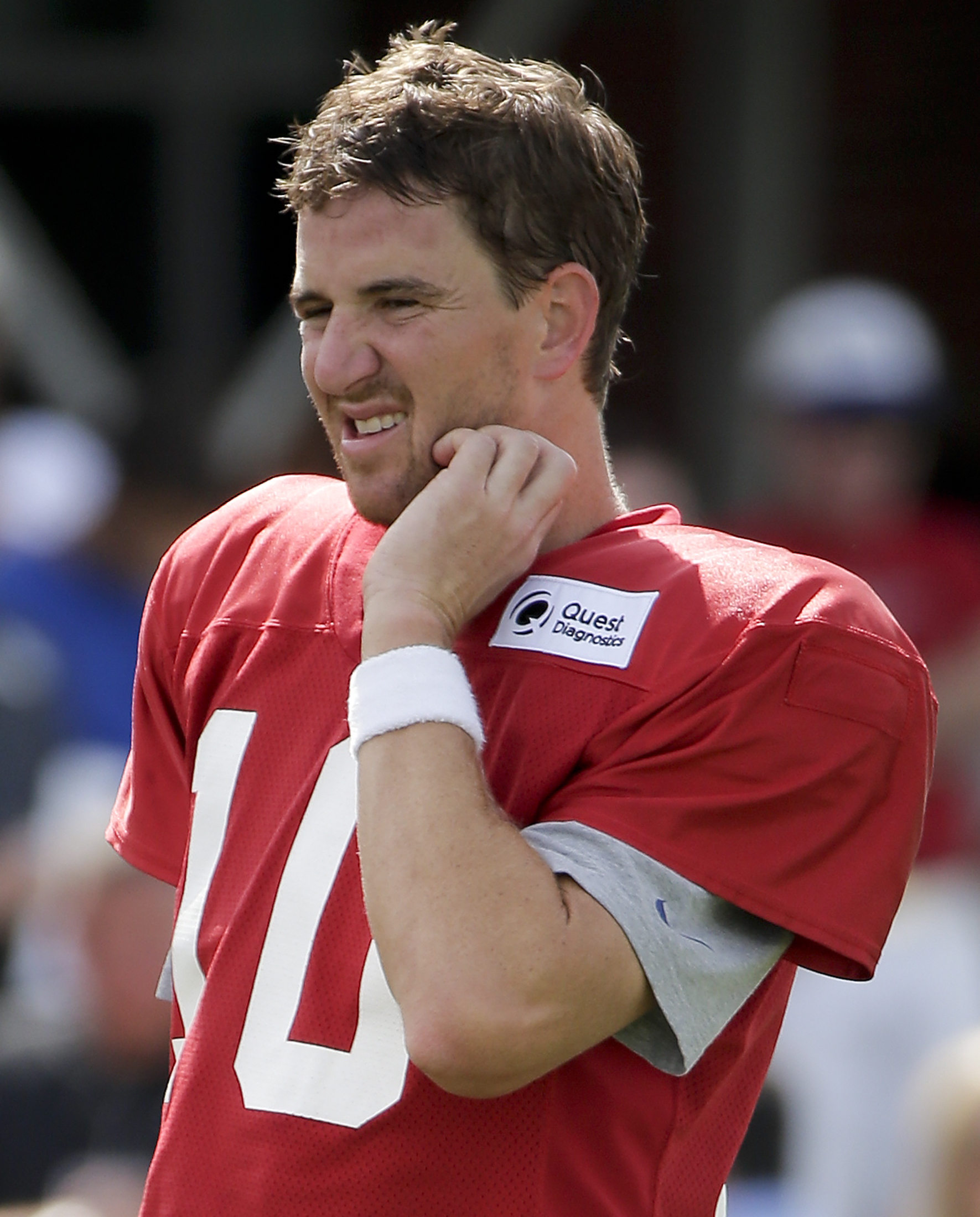 New York Giants quarterback Eli Manning (10) walks to the sideline between drills during the team's NFL football training camp, Thursday, Aug. 6, 2015, in East Rutherford, N.J. (AP Photo/Julie Jacobson)