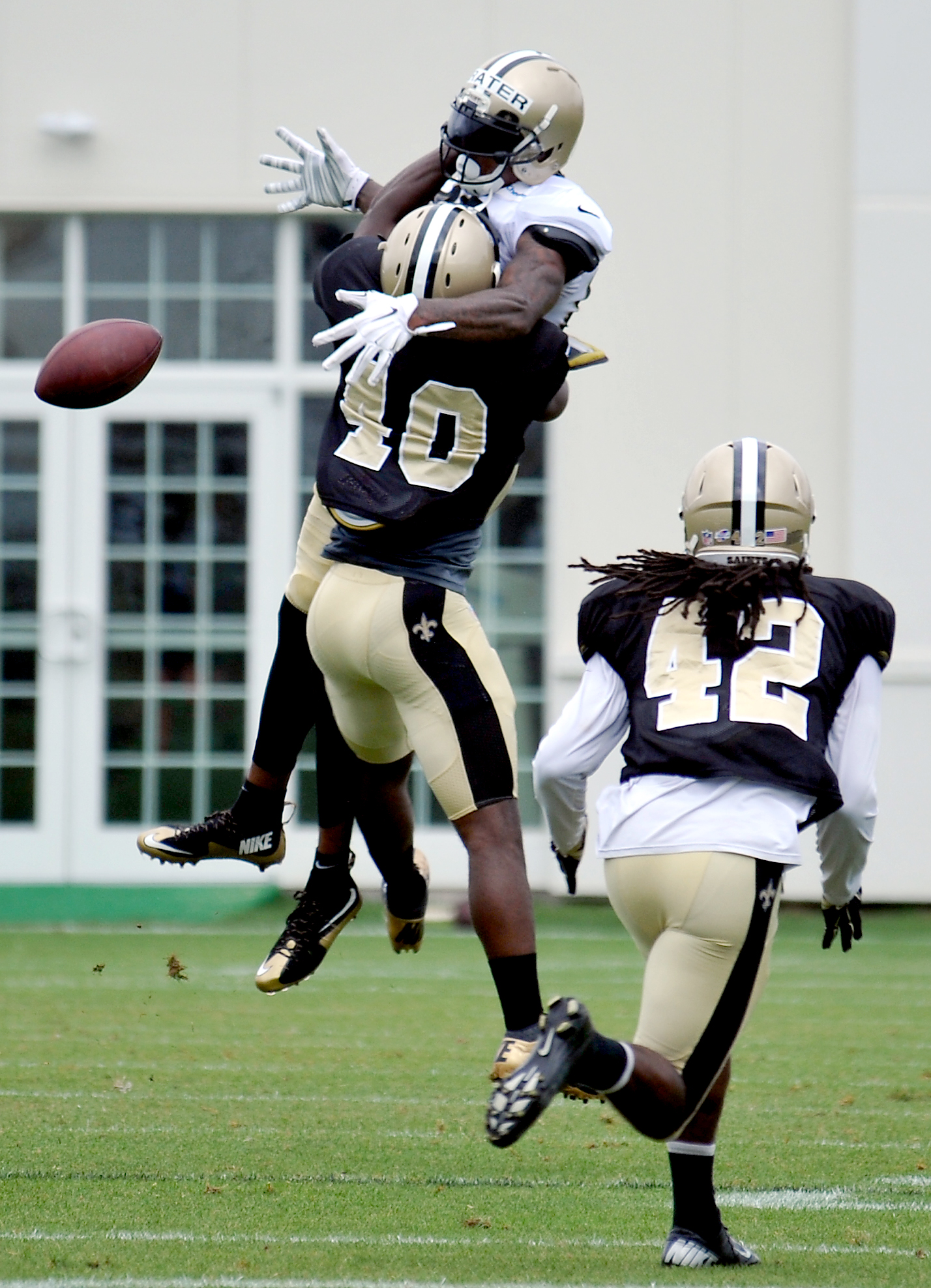 New Orleans Saints wide receiver Kyle Prater (86) leaps for a pass in a scrimmage game with New Orleans Saints defensive back Delvin Breaux (40) defending during the team's NFL football training camp in White Sulphur Springs, W. Va., Friday, Aug. 7, 2015.