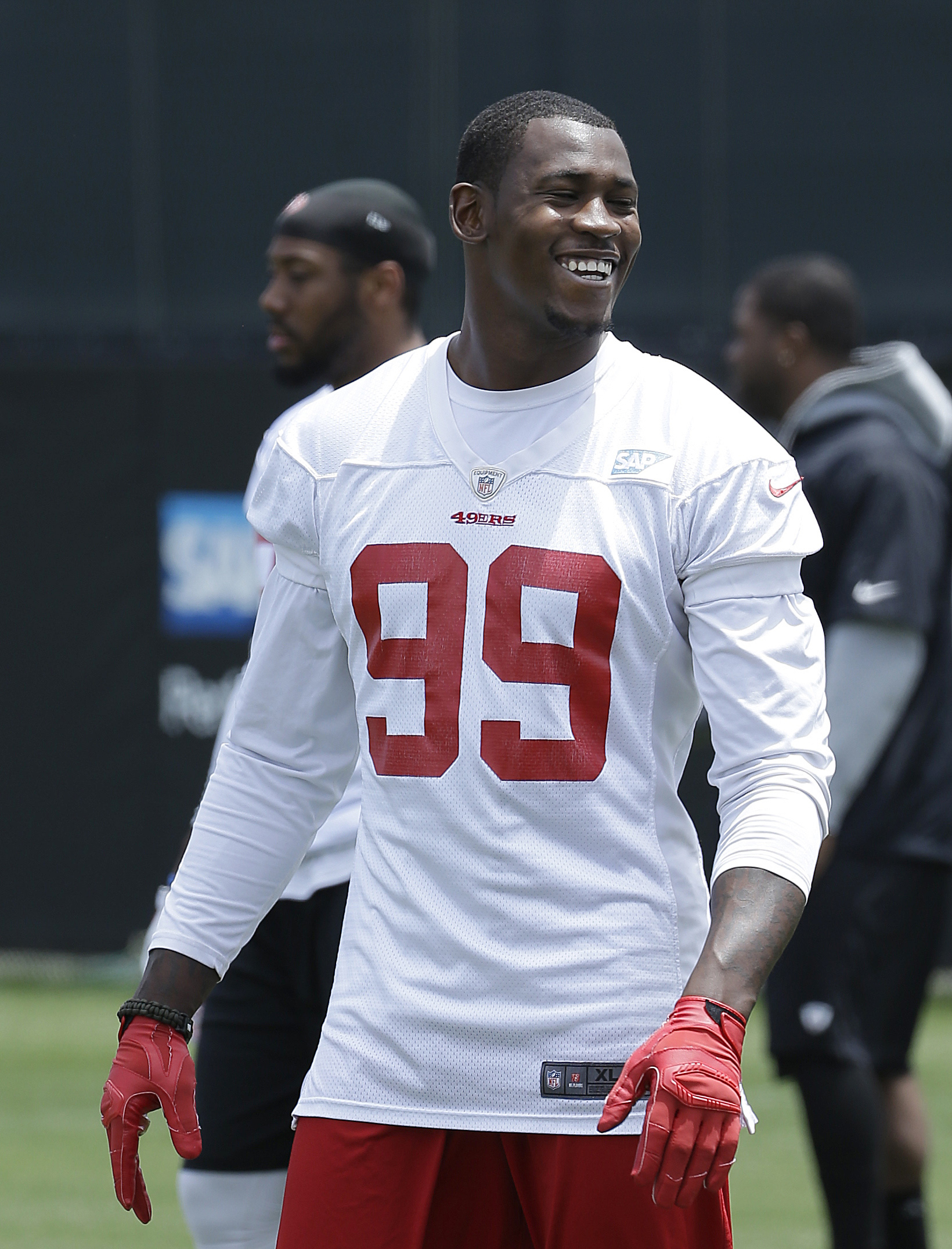 FILE  - In this May 29, 2015 file photo, San Francisco 49ers linebacker Aldon Smith (99) smiles during practice at an NFL football facility in Santa Clara, Calif. Police in Northern California have arrested and accused Smith of hit and run, drunken drivin
