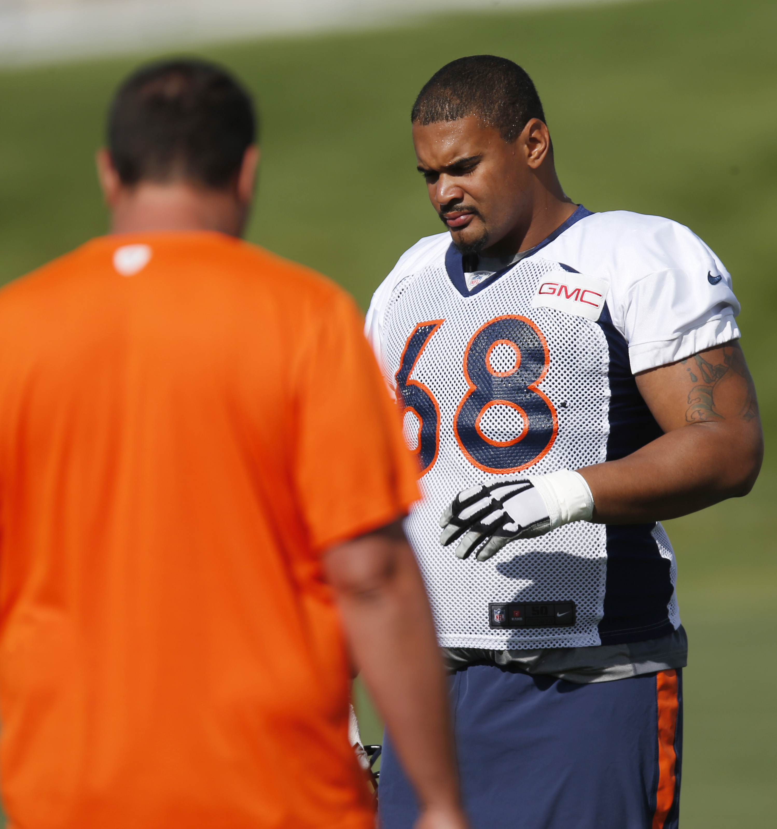 Denver Broncos tackle Ryan Harris takes a break from drills at the team's NFL football training camp Friday, Aug. 7, 2015, in Englewood, Colo. (AP Photo/David Zalubowski)