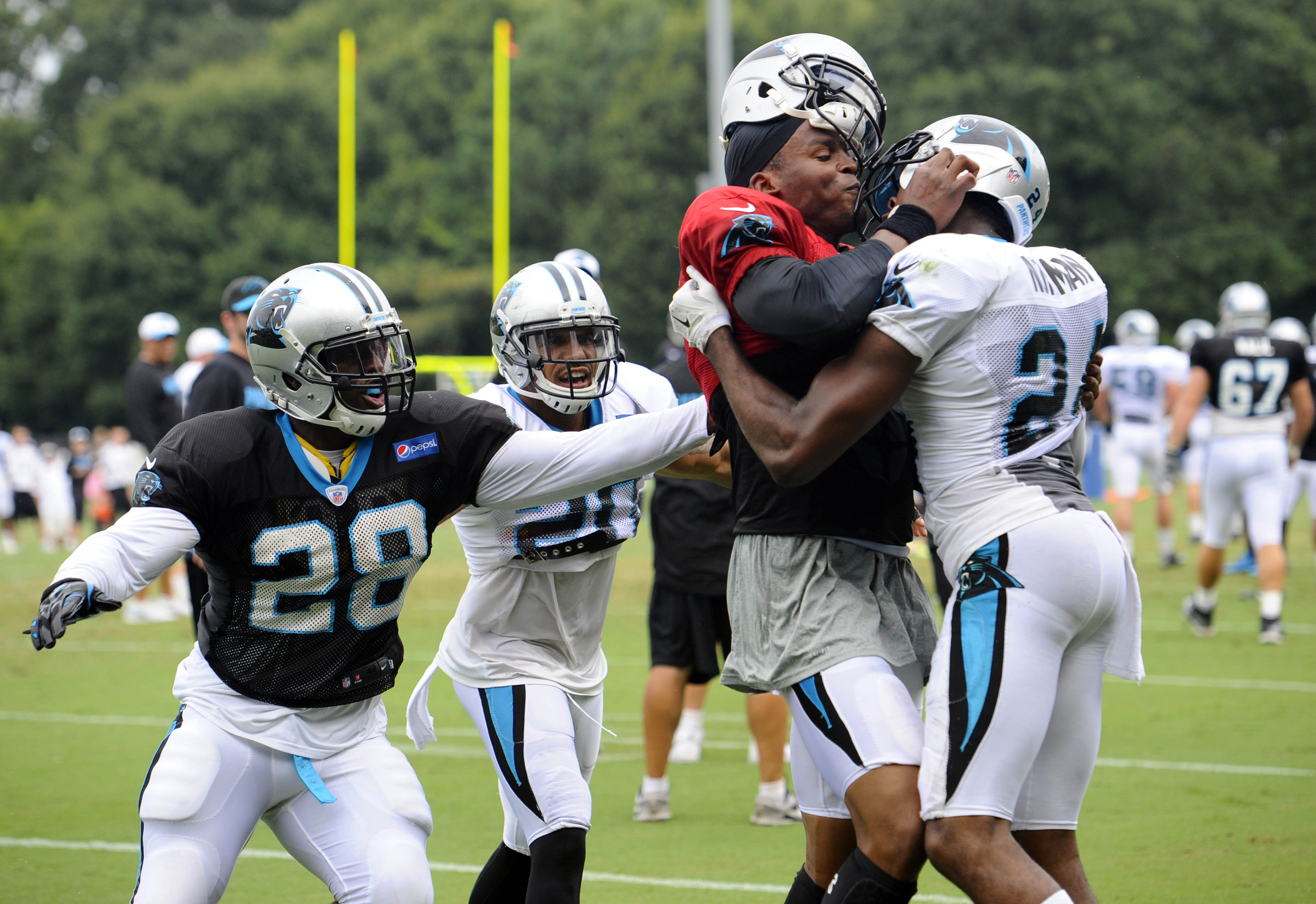 Carolina Panthers' Cam Newton (1) and Josh Norman (24) scuffle at the teams NFL football training camp at Wofford College in Spartanburg, S.C., Monday, Aug. 10, 2015. (David T. Foster III/The Charlotte Observer via AP)  MAGS OUT; TV OUT; MANDATORY CREDIT.