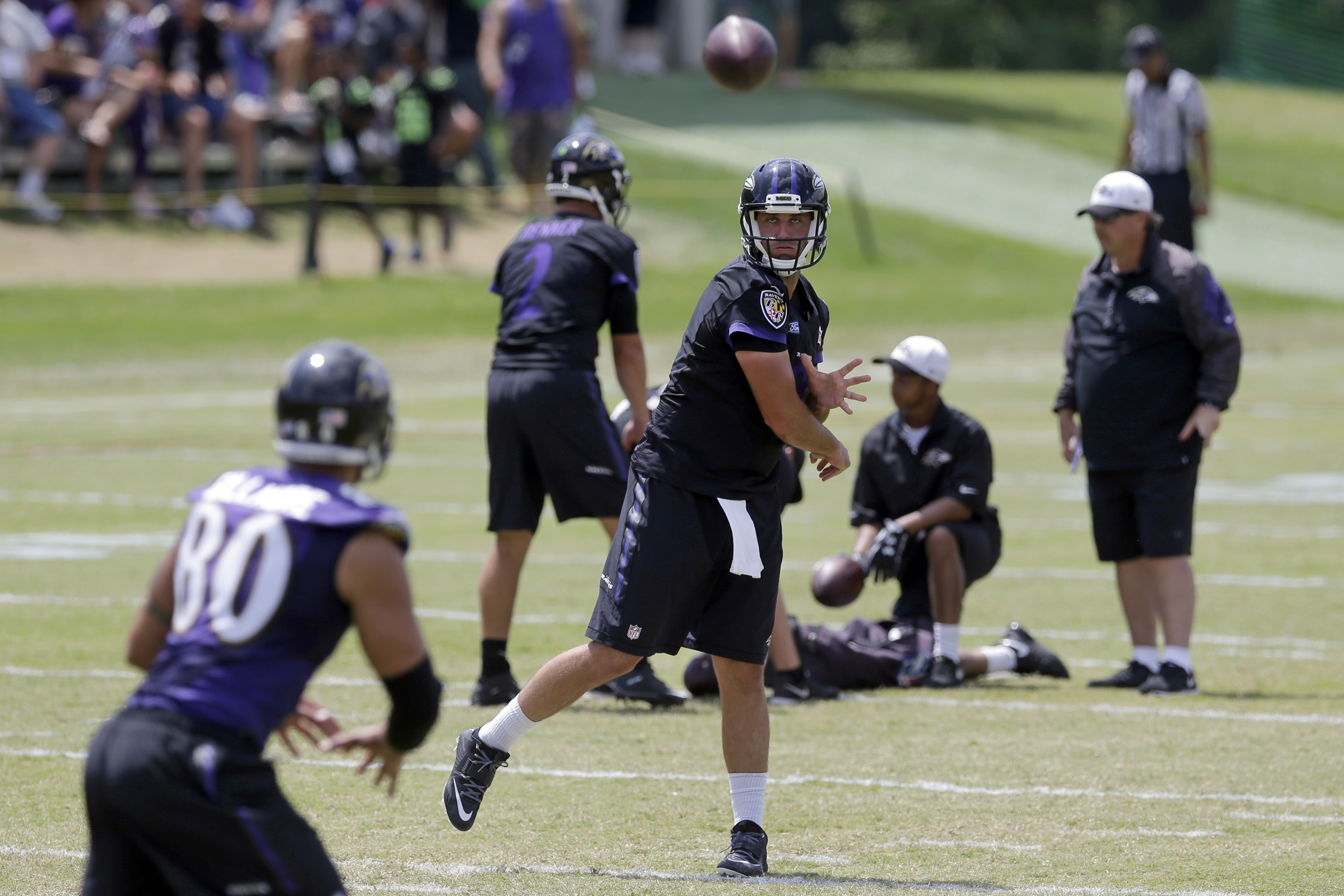 Baltimore Ravens quarterback Matt Schaub, center, throws a pass to tight end Crockett Gillmore (80) during NFL football training camp, Tuesday, Aug. 11, 2015, in Owings Mills, Md. (AP Photo/Patrick Semansky)