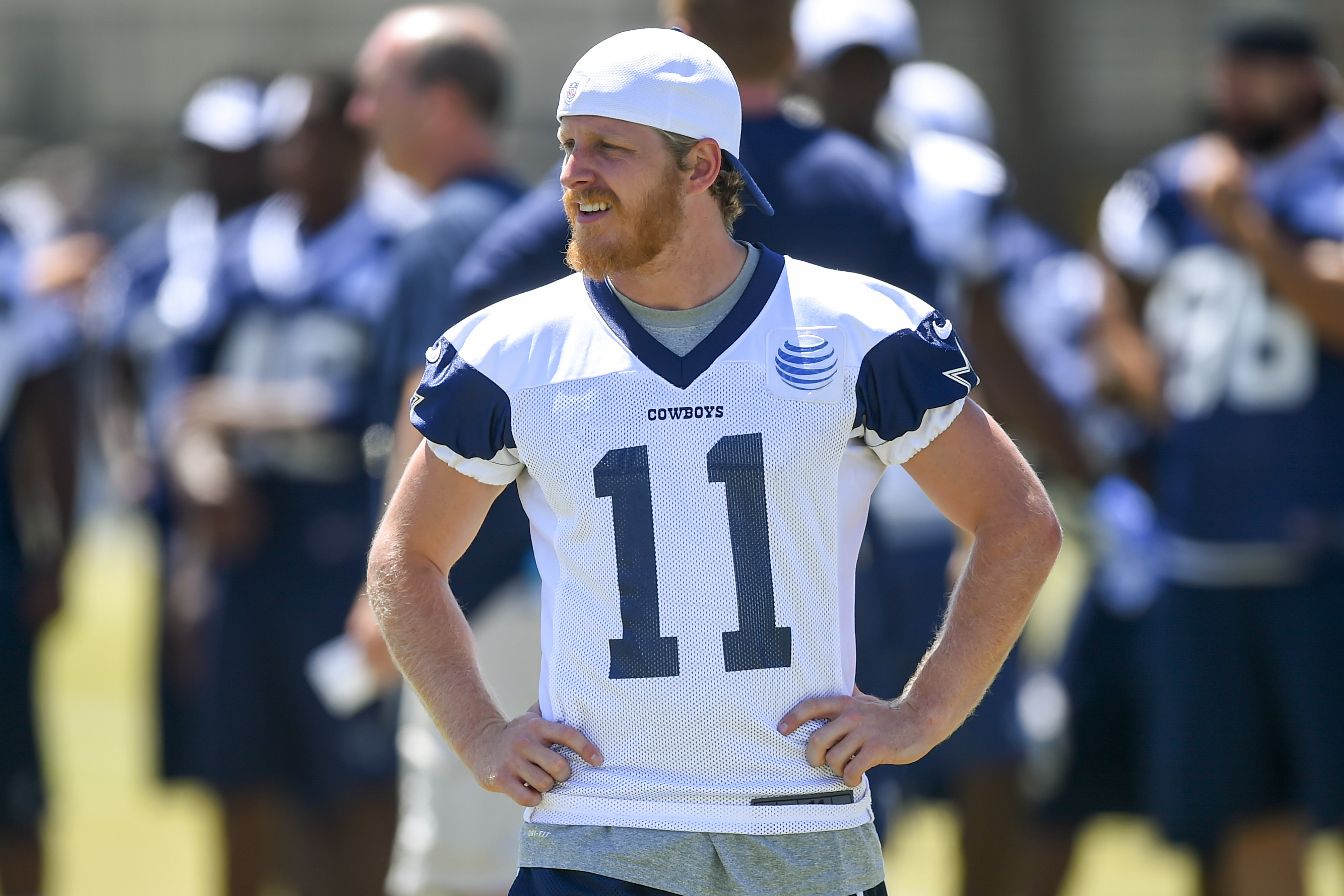 FILE - In this Aug. 4, 2015, file photo, Dallas Cowboys wide receiver Cole Beasley watches other player during NFL football training camp in Oxnard, Calif. Beasley's shifty moves draw loud cheers from fans at Cowboys training camp, and Tony Romo is notici