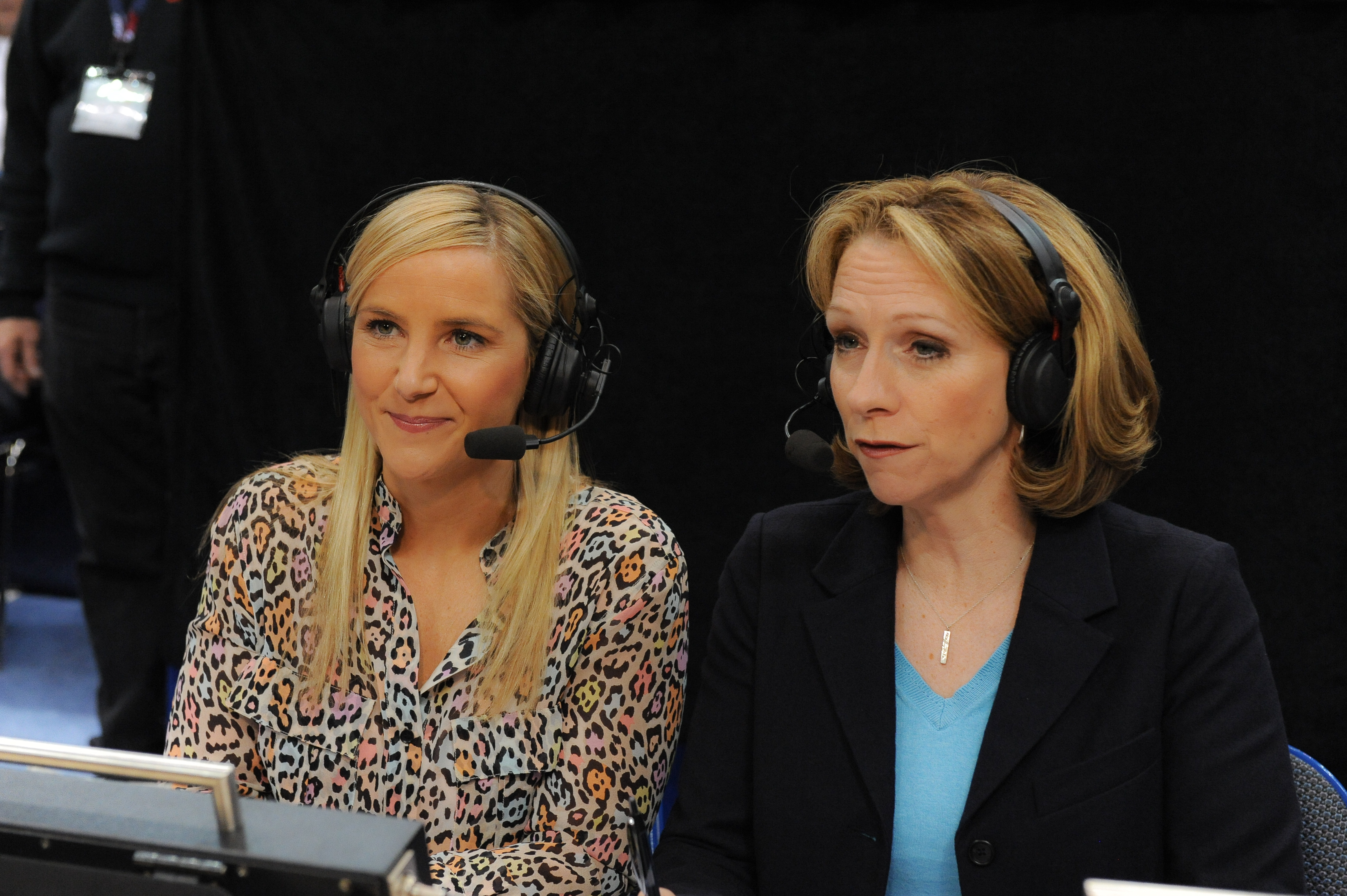 In this March 11, 2013, photo provided by ESPN Images, Brook Weisbrod, left, and Beth Mowins are shown during the women's Big East Championship basketball game in Hartford, Conn. Beth Mowins has spent her accomplished career as a play-by-play announcer tr