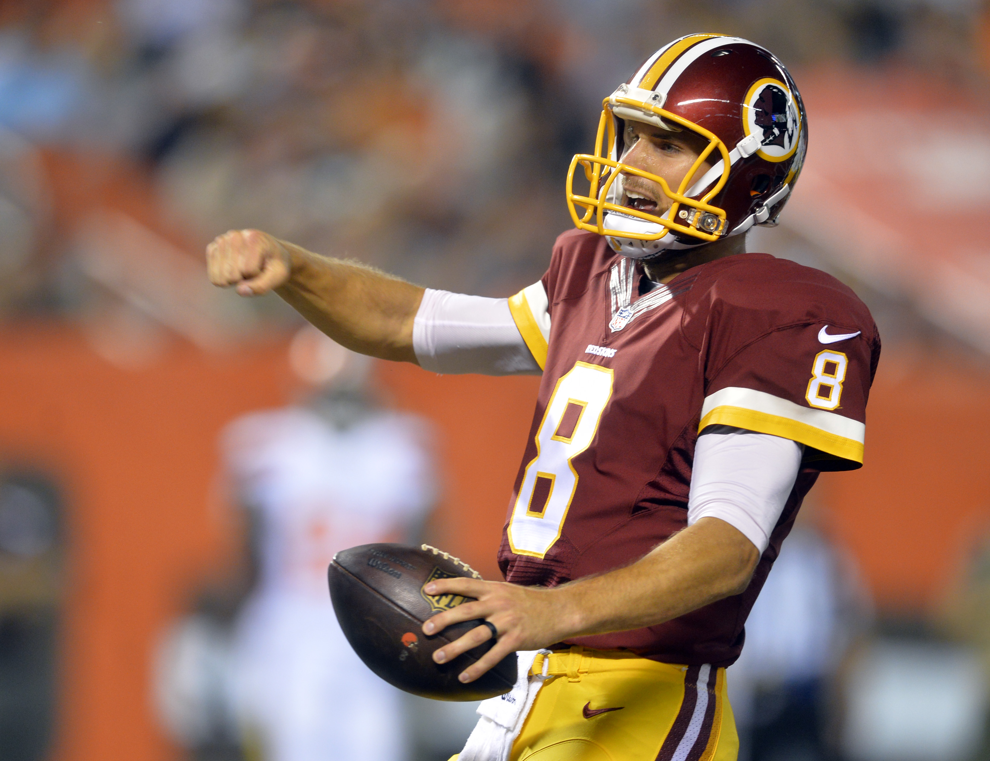 Washington Redskins quarterback Kirk Cousins celebrates after scrambling in for a 4-yard touchdown during the second quarter of an NFL preseason football game against the Cleveland Browns, Thursday, Aug. 13, 2015, in Cleveland. (AP Photo/David Richard)