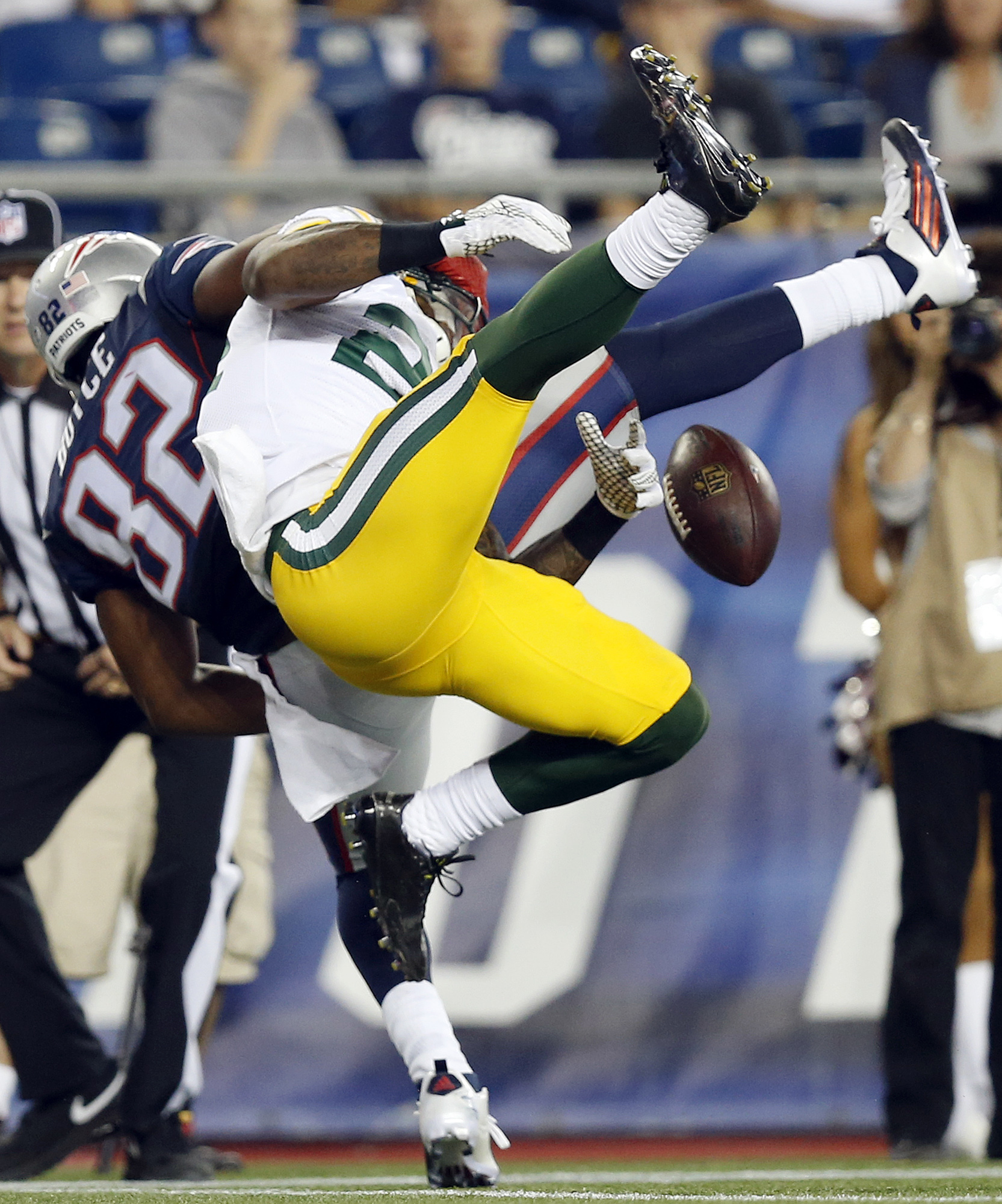 Green Bay Packers cornerback Quinten Rollins (24) breaks up a pass intended for New England Patriots wide receiver Josh Boyce (82) during the first half of an NFL preseason football game Thursday, Aug. 13, 2015, in Foxborough, Mass.  (AP Photo/Michael Dwy