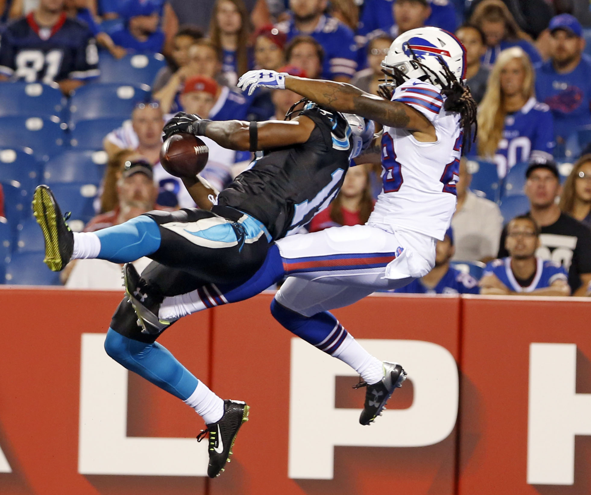 Buffalo Bills cornerback Ronald Darby, right, breaks up a pass intended for Carolina Panthers wide receiver Devin Funchess (17) during the second half of an NFL preseason football game on Friday, Aug. 14, 2015, in Orchard Park, N.Y. (AP Photo/Heather Ains