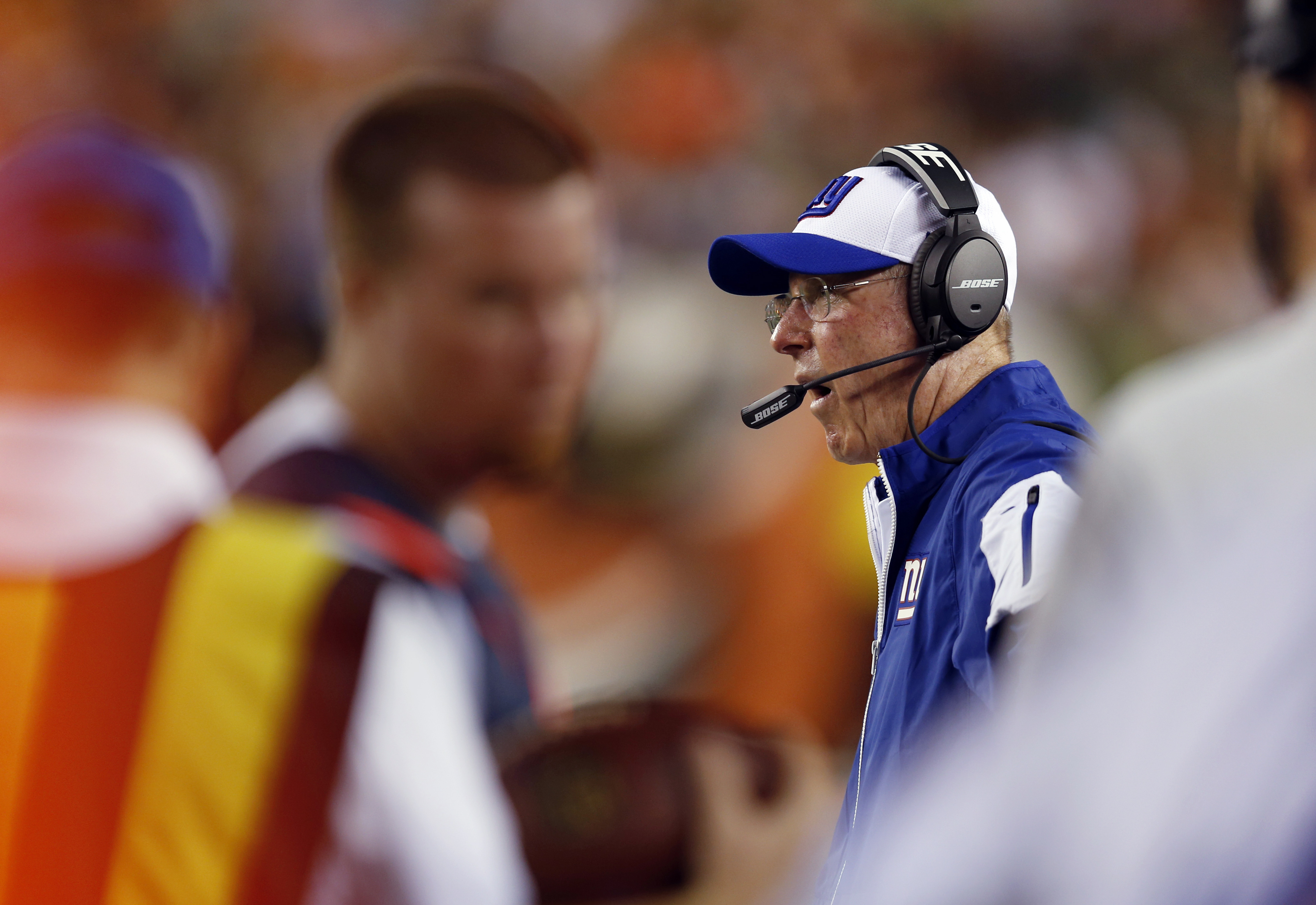 New York Giants coach Tom Coughlin yells from the sideline during the first half of the Giants' NFL preseason football game against the Cincinnati Bengals in Cincinnati, Friday, Aug. 14, 2015. (AP Photo/Gary Landers)