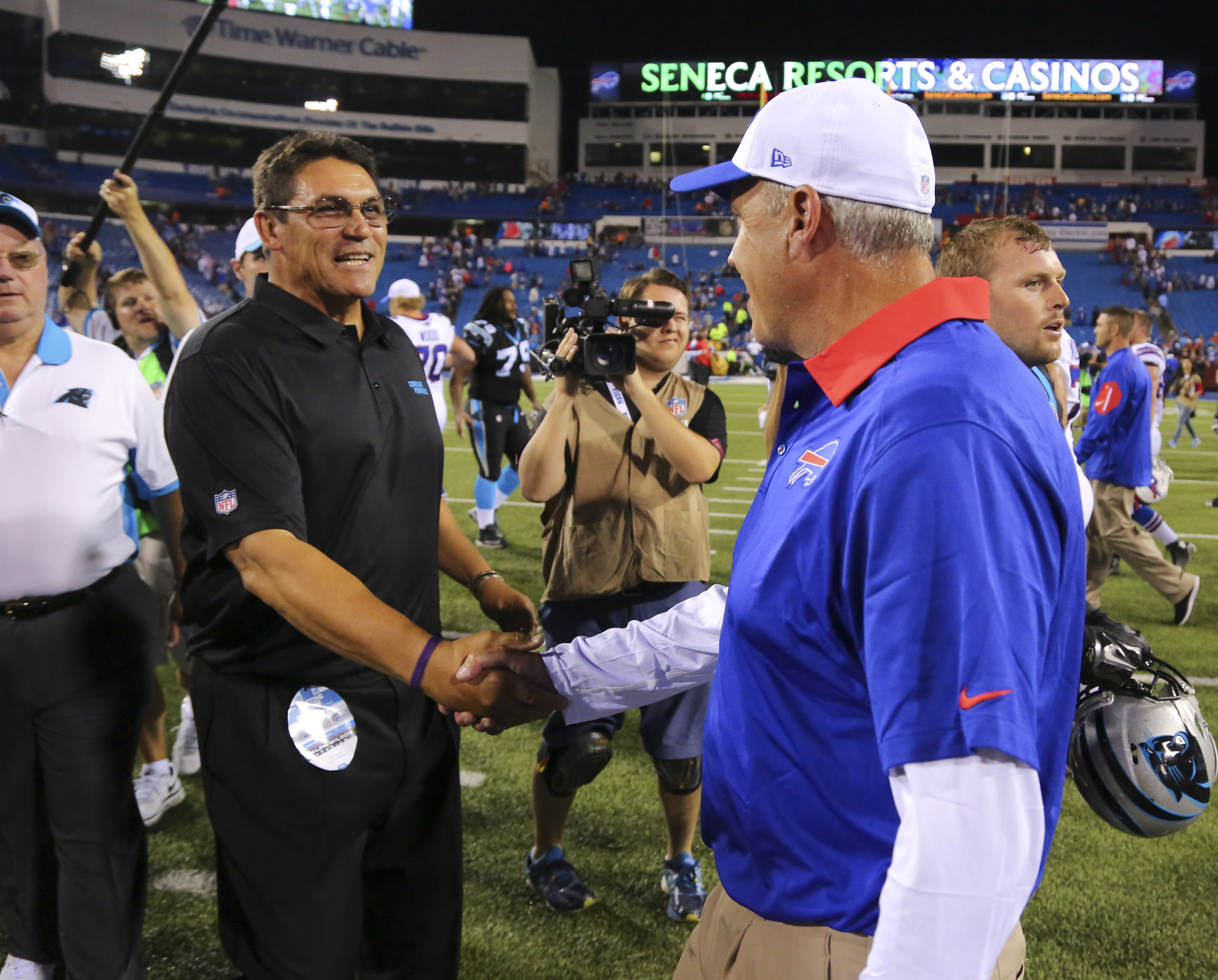 Carolina Panthers head coach Ron Rivera, left, and Buffalo Bills head coach Rex Ryan shake hands after an NFL preseason football game on Friday, Aug. 14, 2015, in Orchard Park, N.Y. The Panthers won 25-24. (AP Photo/Bill Wippert)