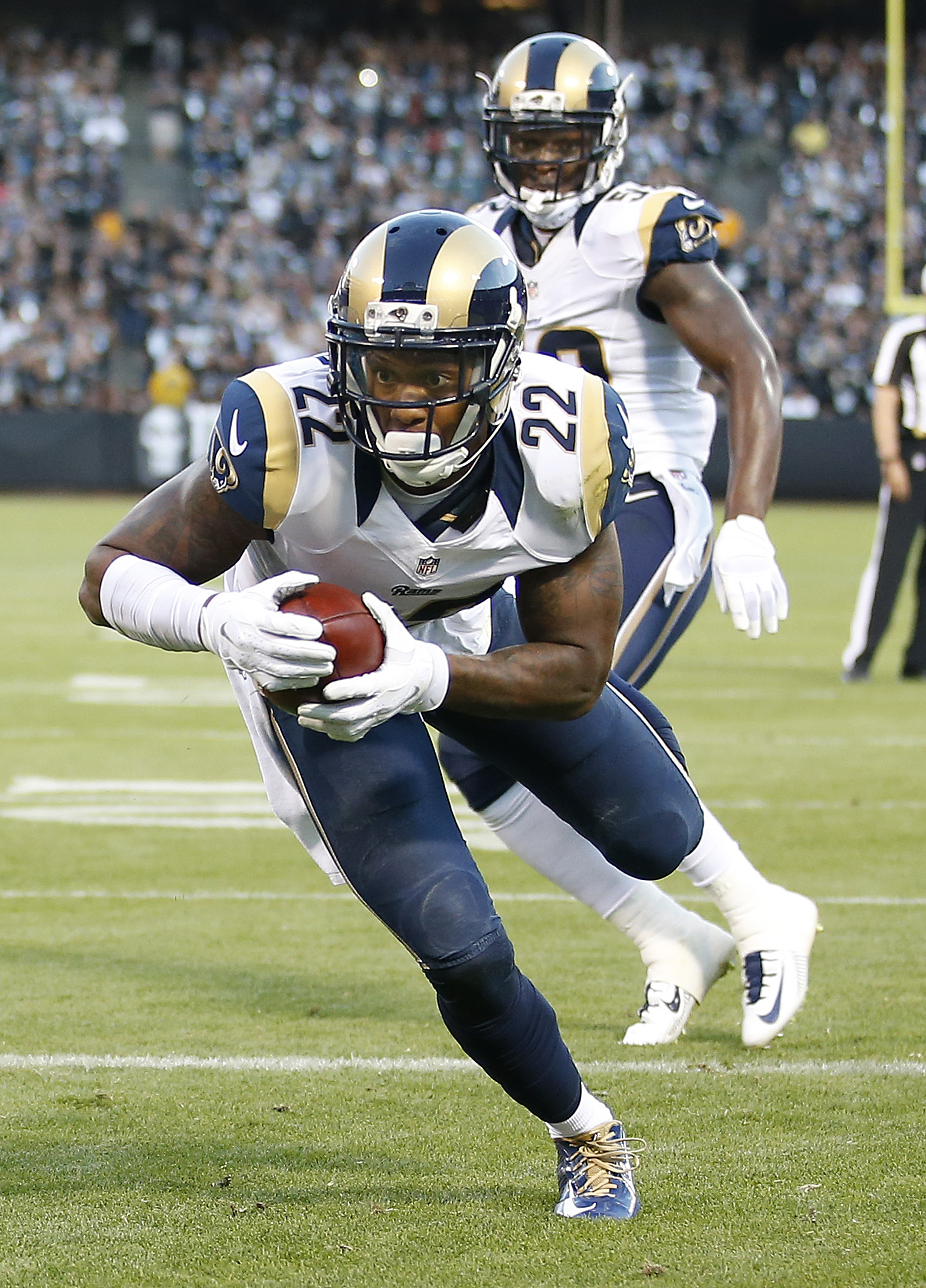 St. Louis Rams cornerback Trumaine Johnson (22) intercepts a pass against the Oakland Raiders during the first half of an NFL preseason football game in Oakland, Calif., Friday, Aug. 14, 2015. (AP Photo/Tony Avelar)