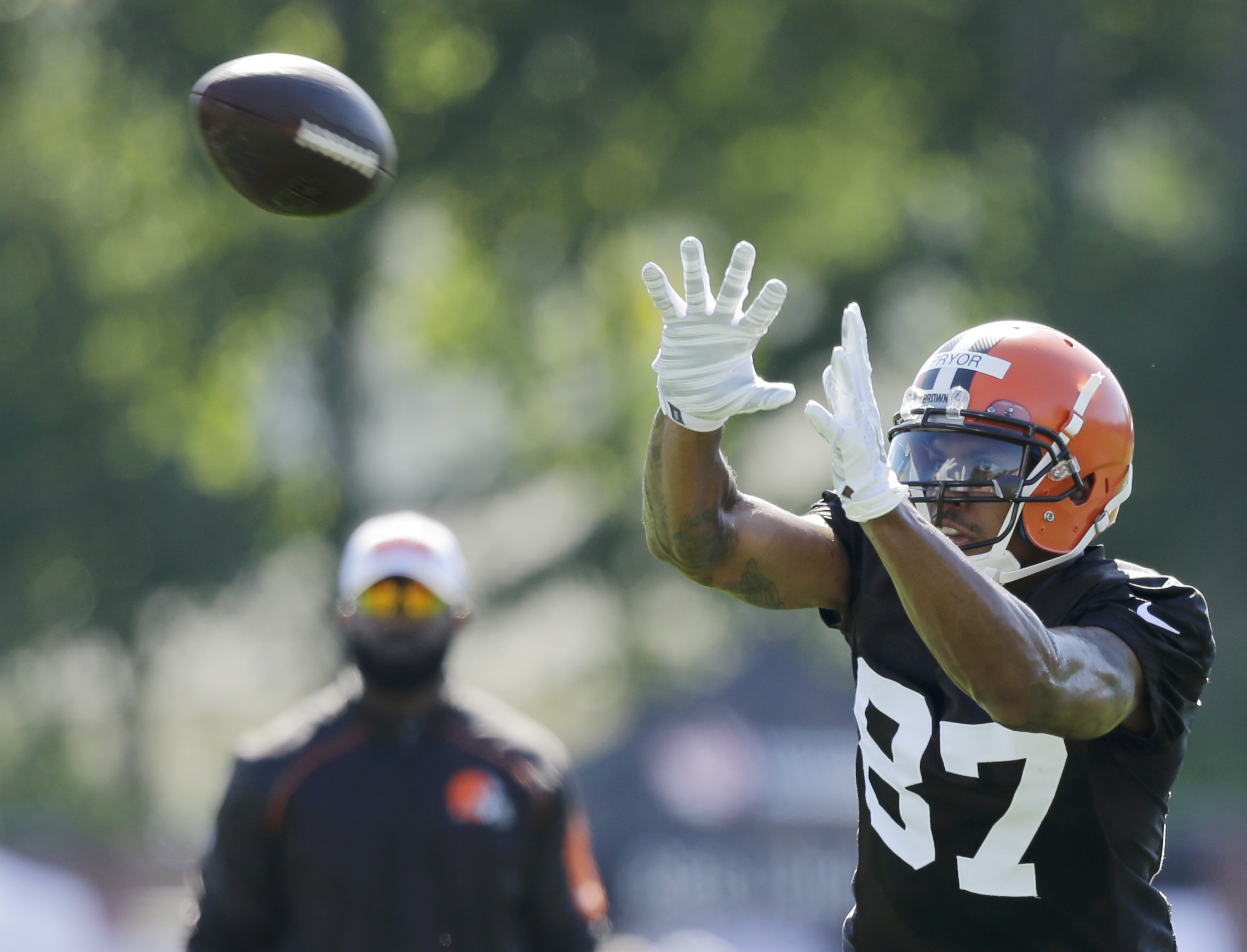 FILE - In this July 30, 2015 file photo, Cleveland Browns wide receiver Terrelle Pryor catches a pass during practice at the NFL football team's training camp, in Berea, Ohio. Pryor has returned to practice after missing more than a week of training camp