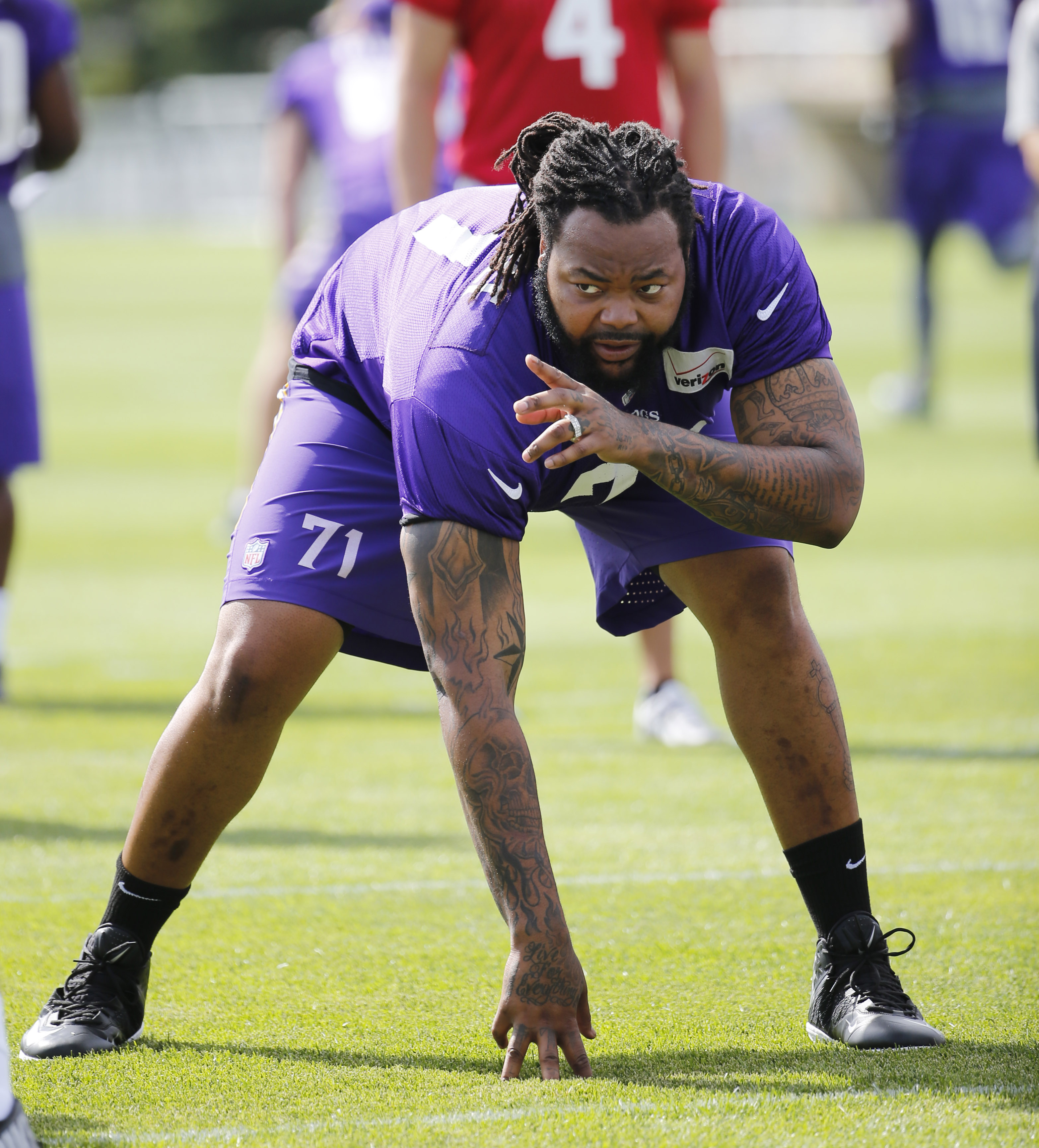 Minnesota Vikings tackle Phil Loadholt identifies a defensive player during practice at an NFL football training camp on the campus of Minnesota State University, Sunday, July 26, 2015, in Mankato, Minn. (AP Photo/Charles Rex Arbogast)
