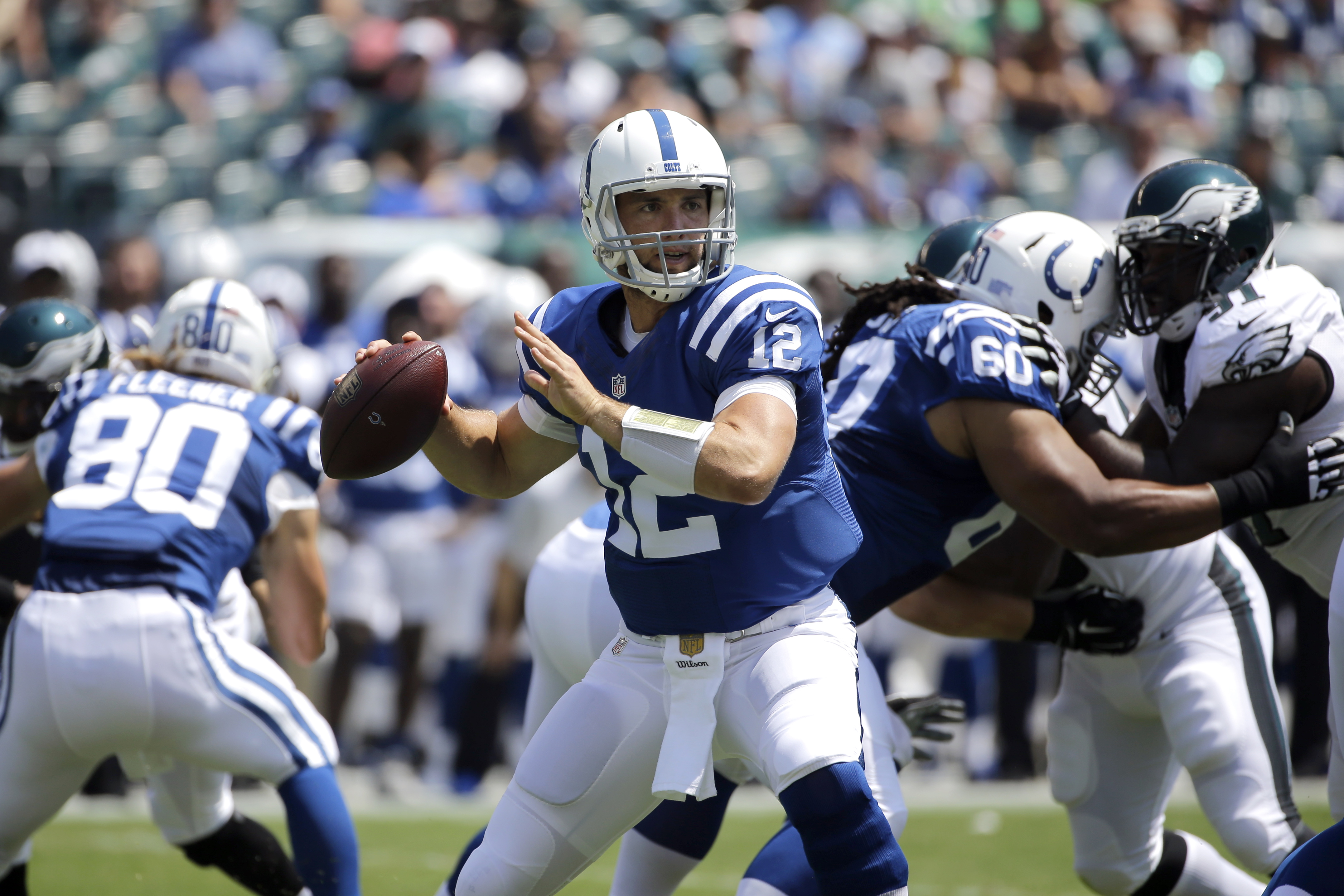 Indianapolis Colts' Andrew Luck looks to pass during the first half of a preseason NFL football game against the Philadelphia Eagles, Sunday, Aug. 16, 2015, in Philadelphia. (AP Photo/Michael Perez)