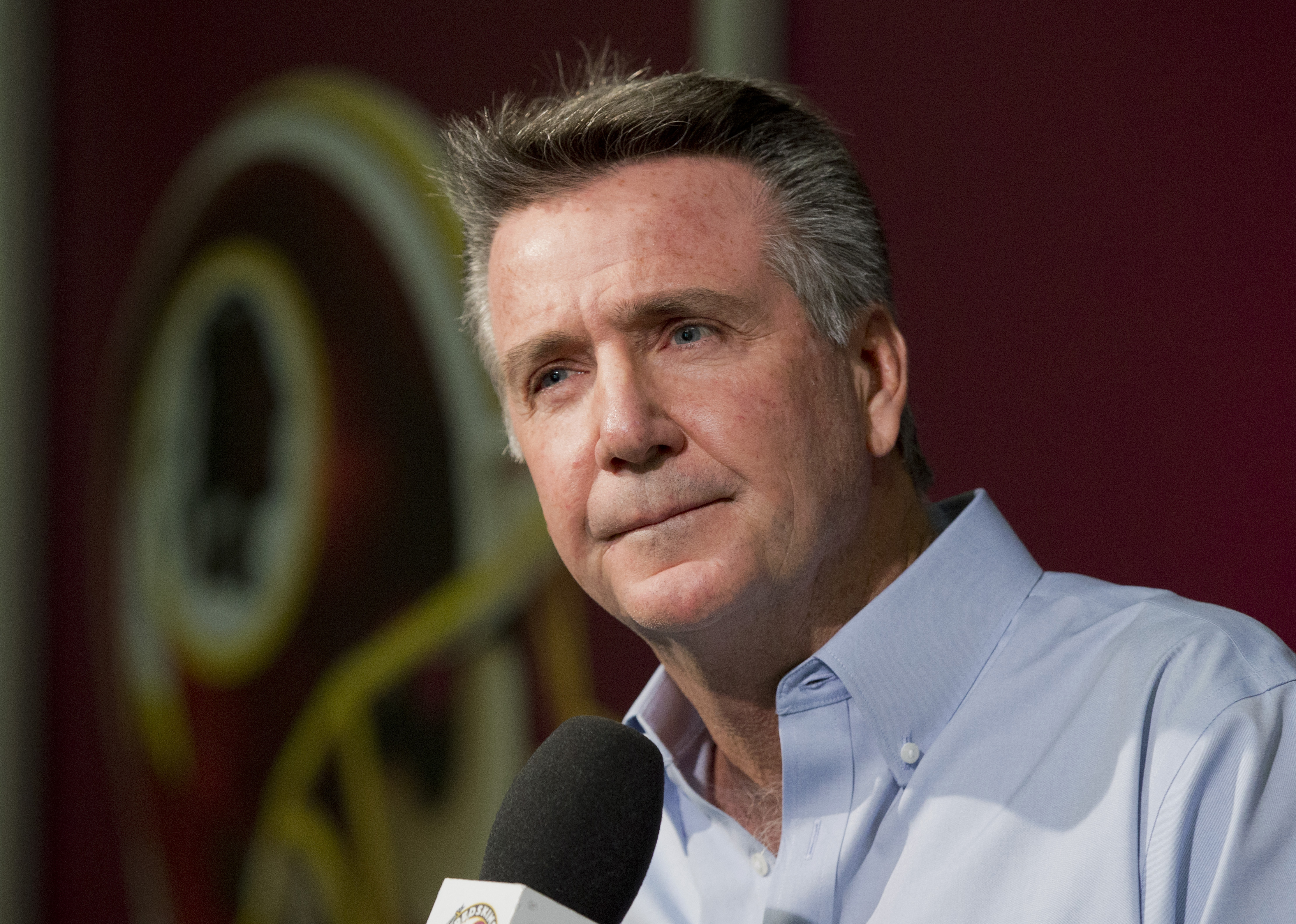 FILE - In this Dec.  31, 2014 file photo, Washington Redskins President and General Manager Bruce Allen speaks to reporters during an NFL football news conference at the Redskins Park in Ashburn, Va. Allen says the Washington Redskins will not reconsider