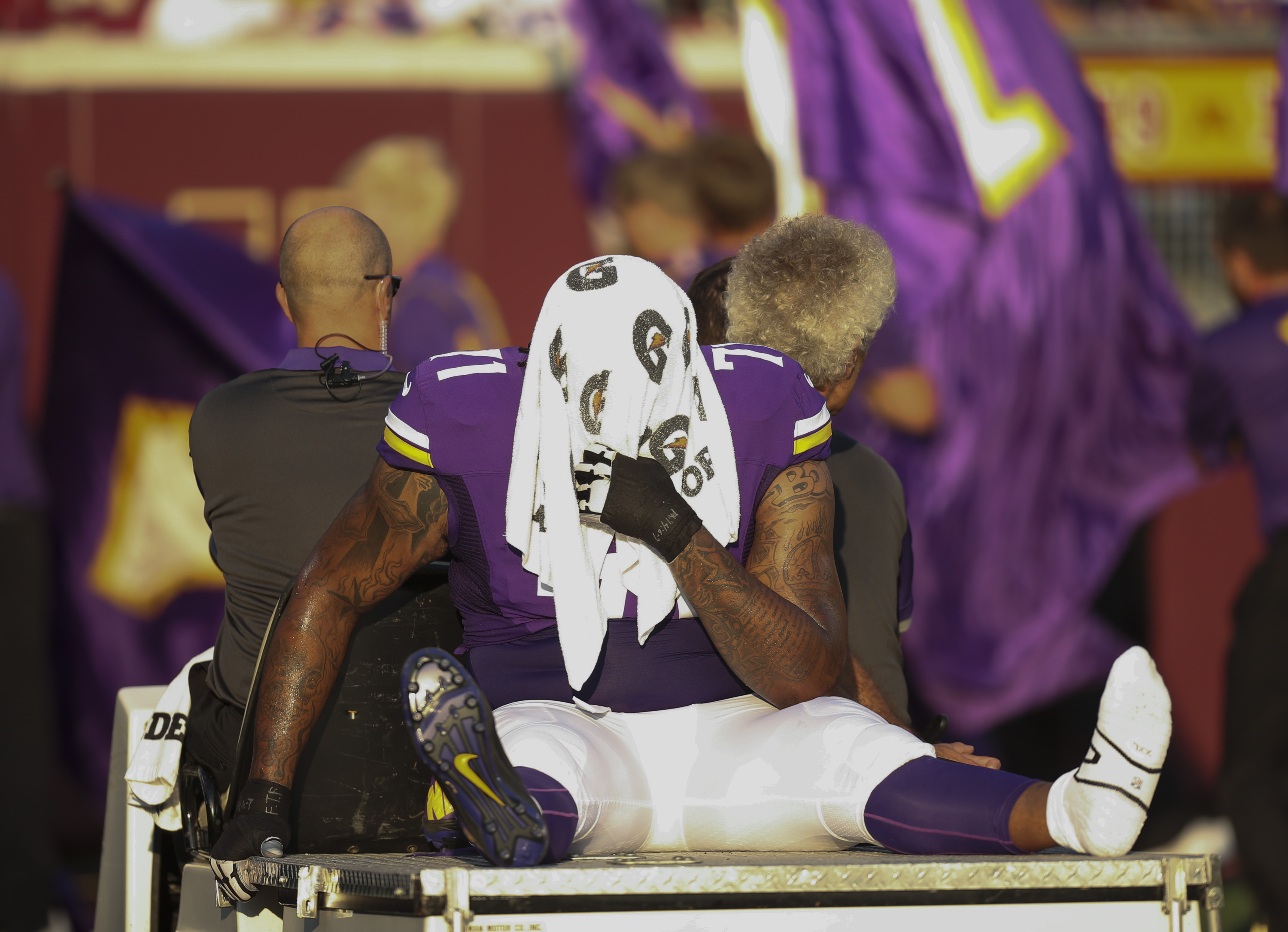 FILE - In this Aug. 15, 2015, file photo, Minnesota Vikings right tackle Phil Loadholt is carted off the field during the first quarter of the Vikings' NFL preseason football game against the Tampa Bay Buccaneers in Minneapolis. With Loadholt likely lost