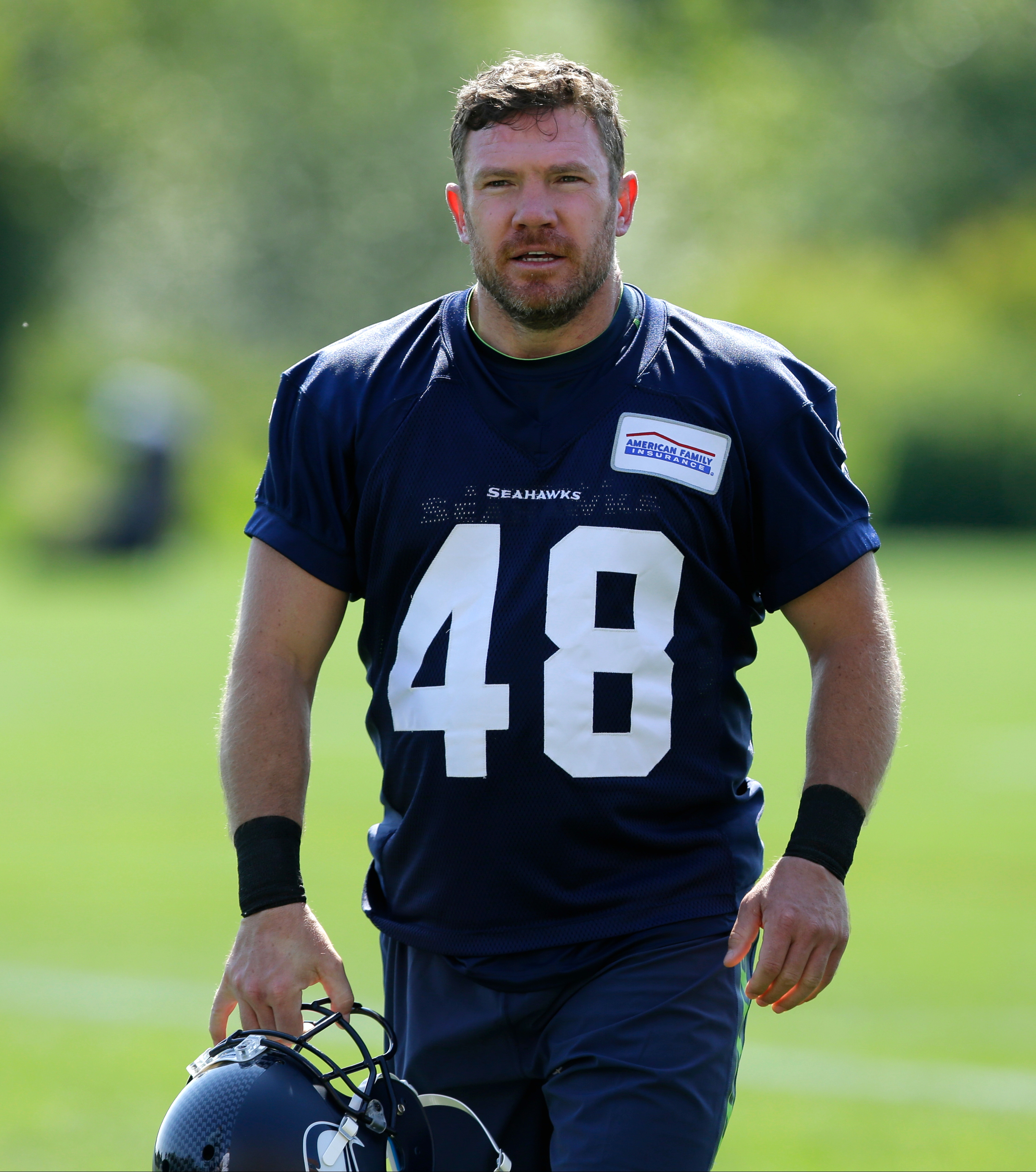 U.S. Army veteran and former Texas long snapper Nate Boyer walks off the field following Seattle Seahawks NFL football rookie minicamp, Friday, May 8, 2015 in Renton, Wash. (AP Photo/Ted S. Warren)