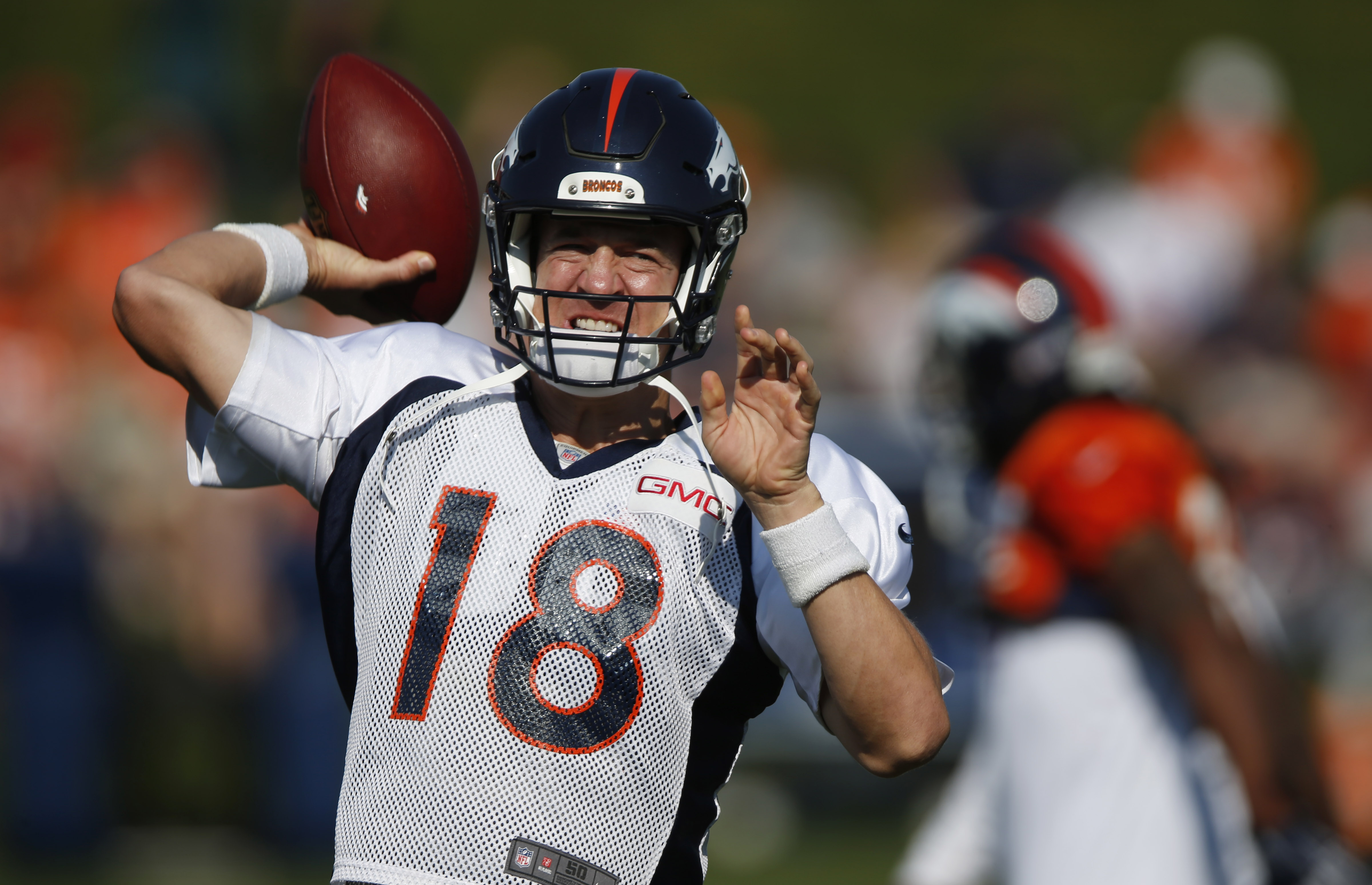 Denver Broncos quarterback Peyton Manning throws during the morning session at the team's NFL football training camp Tuesday, Aug. 18, 2015, in Englewood, Colo. (AP Photo/David Zalubowski)