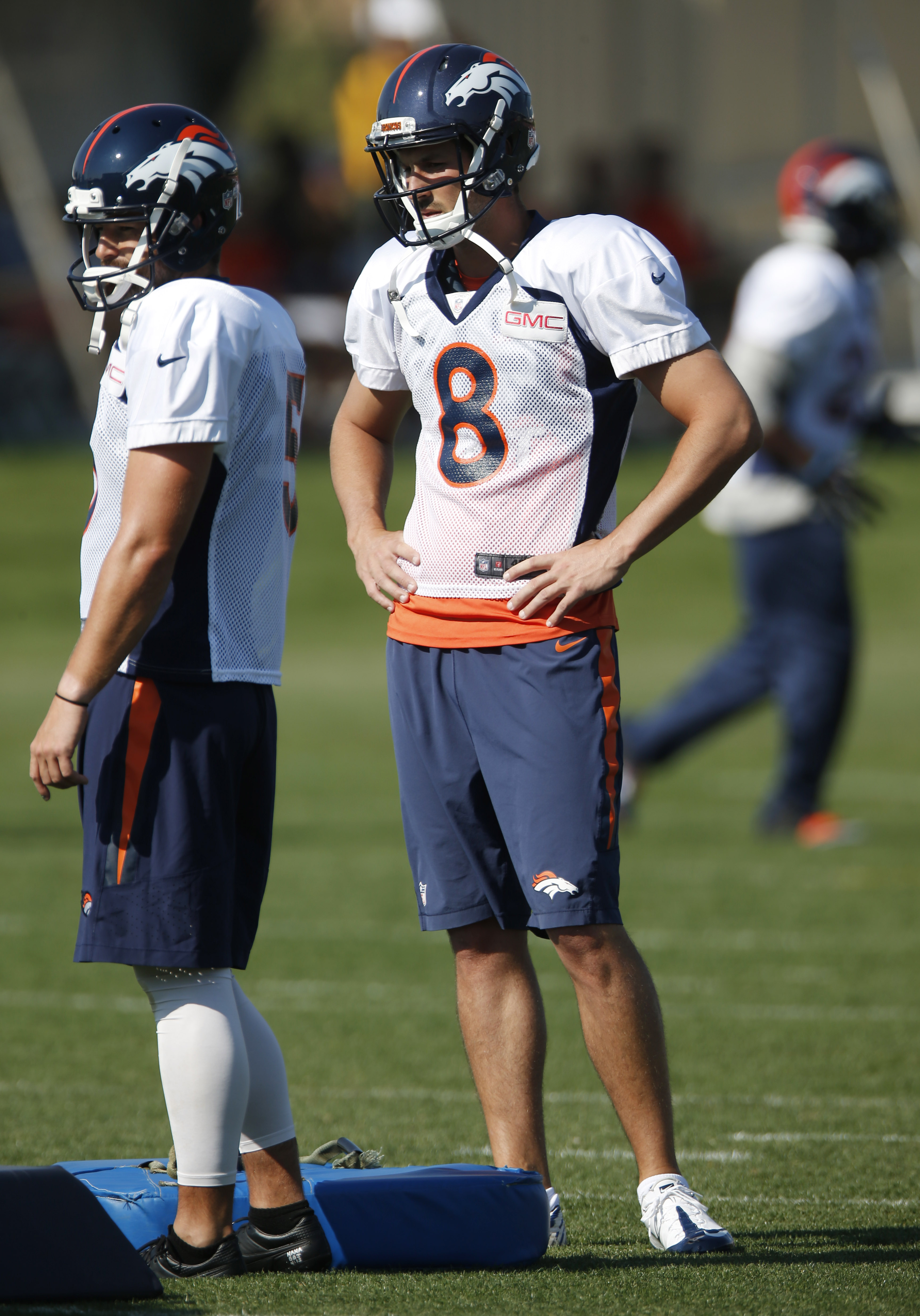 Denver Broncos kicker Brandon McManus, right, looks on with punter Spencer Lanning during the morning session at the team's NFL football training camp Tuesday, Aug. 18, 2015, in Englewood, Colo. (AP Photo/David Zalubowski)