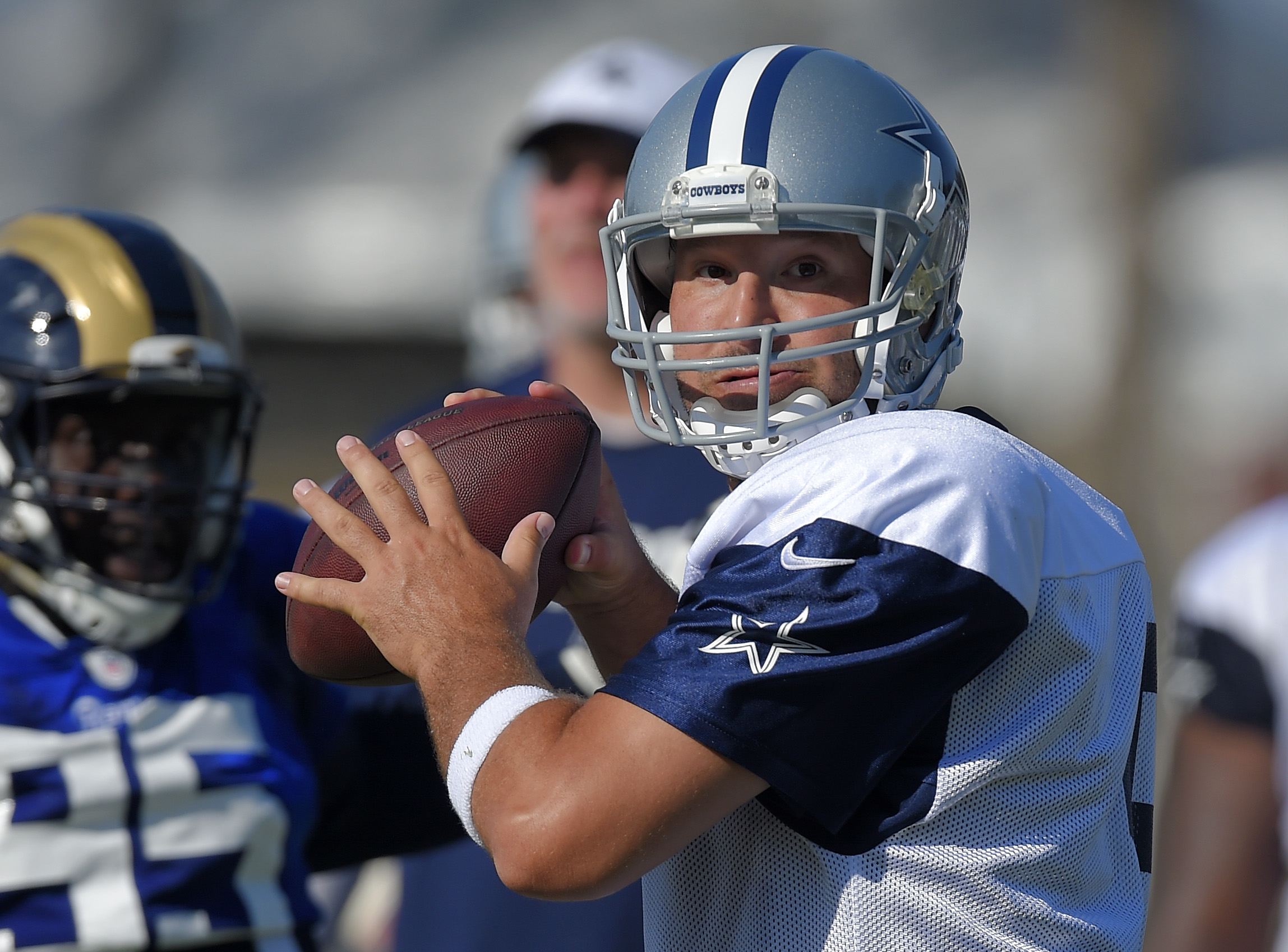 Dallas Cowboys quarterback Tony Romo looks to pass during a joint NFL football training camp with the St. Louis Rams, Tuesday, Aug. 18, 2015, in Oxnard, Calif. (AP Photo/Mark J. Terrill)