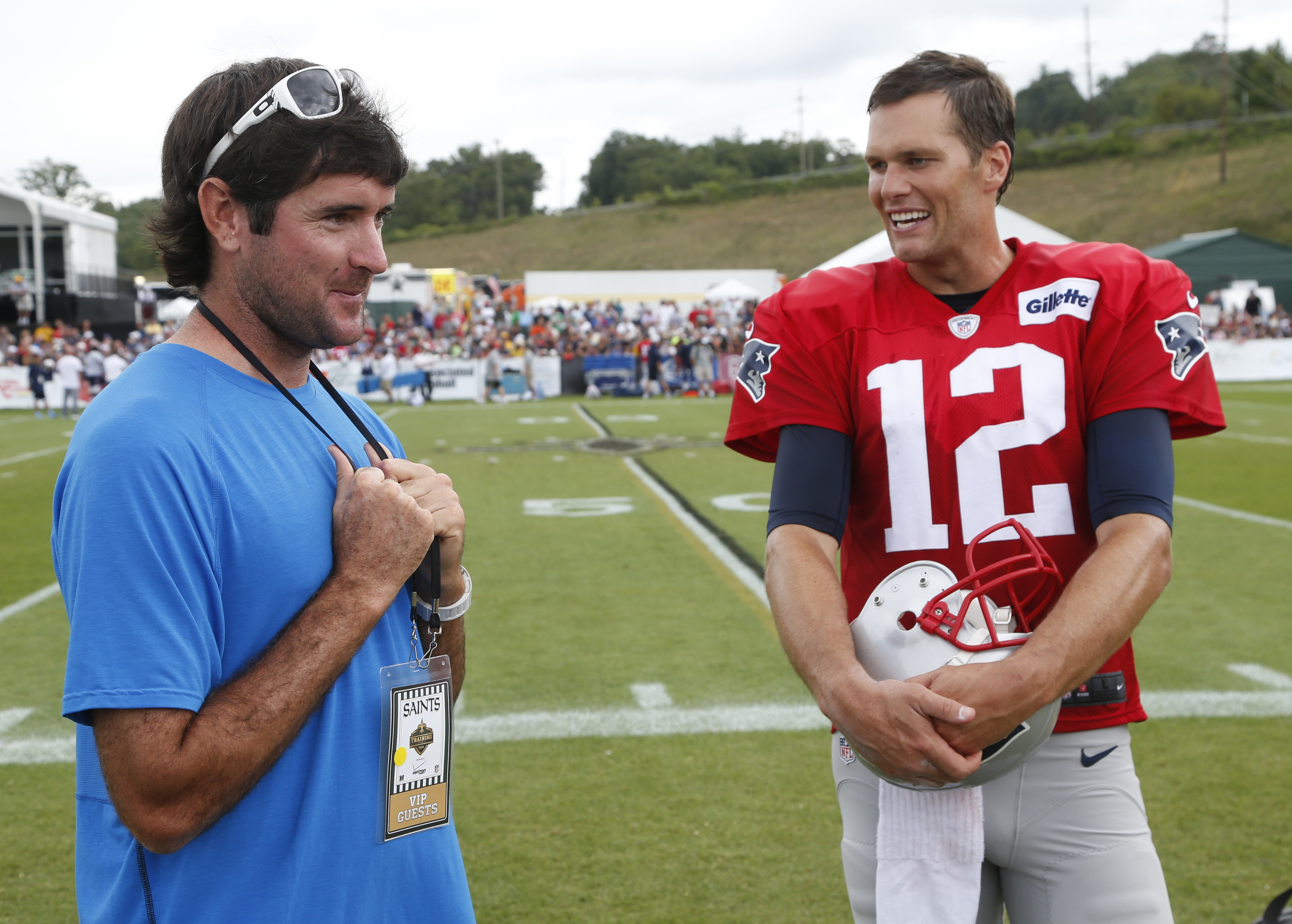 New England Patriots quarterback Tom Brady (12) talks with pro golfer Bubba Watson after a joint practice between the Patriots and New Orleans Saints at the Saint's NFL football training camp in White Sulphur Springs, W.Va., Thursday, Aug. 20, 2015.  (AP
