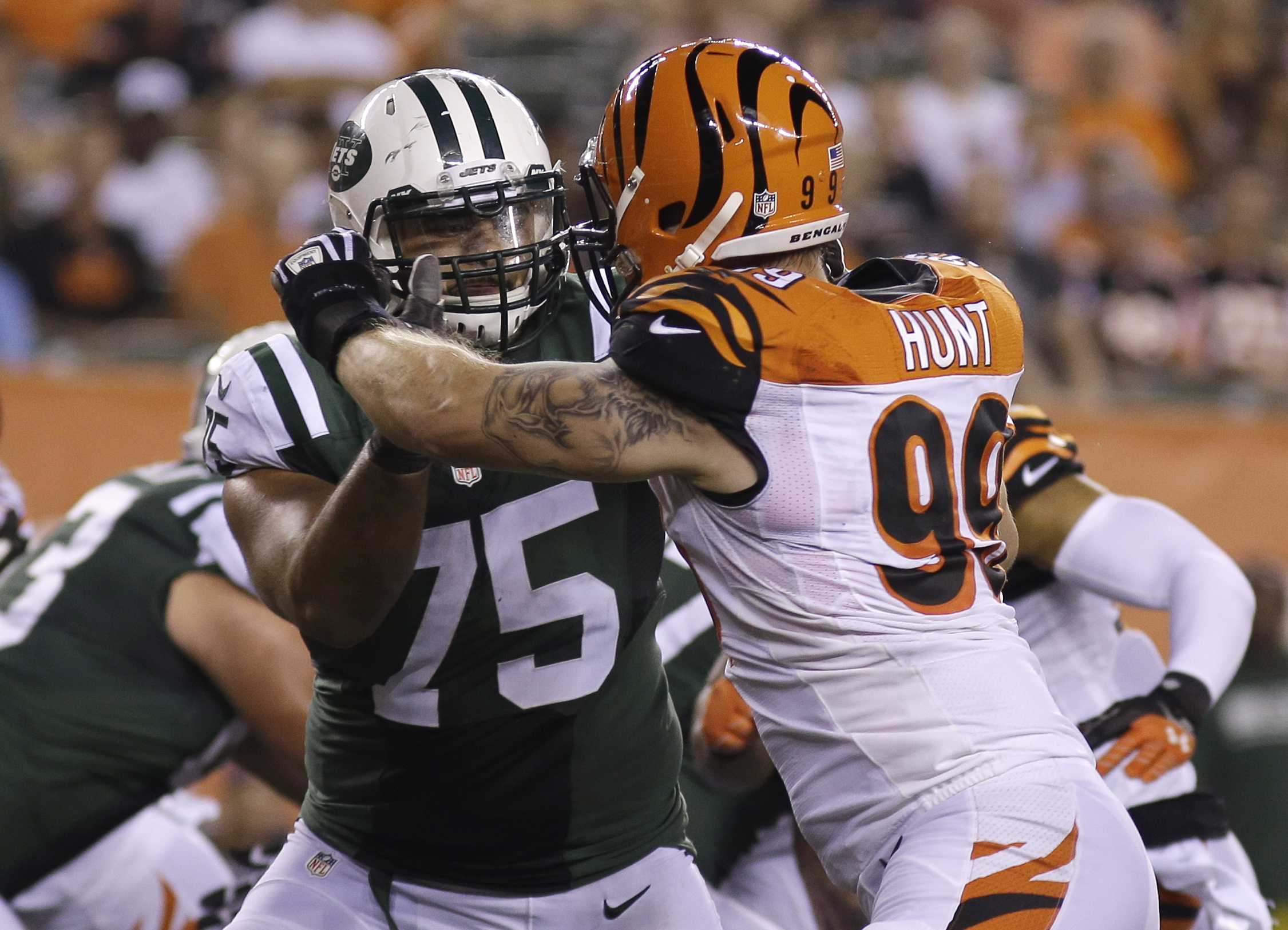 FILE - In this Aug. 16, 2014, file photo, New York Jets offensive tackle Oday Aboushi (75) works against Cincinnati Bengals defensive end Margus Hunt (99)  during an NFL preseason football game in Cincinnati. Aboushi is facing the possibility of going fro
