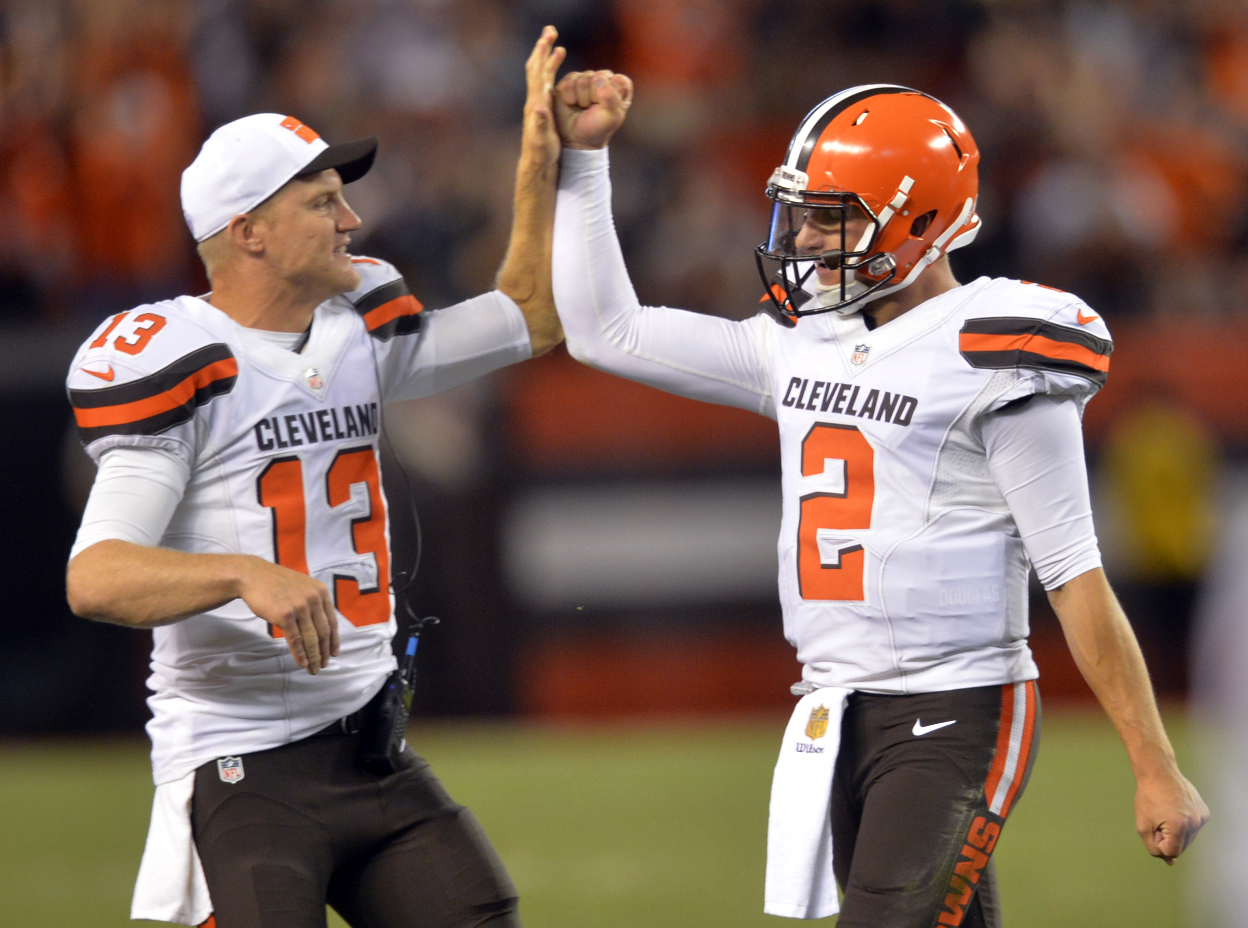 Cleveland Browns quarterback Josh McCown (13) congratulates Johnny Manziel (2) after Manziel threw a 21-yard touchdown pass to Shane Wynn during the fourth quarter of an NFL preseason football game against the Buffalo Bills, Thursday, Aug. 20, 2015, in Cl
