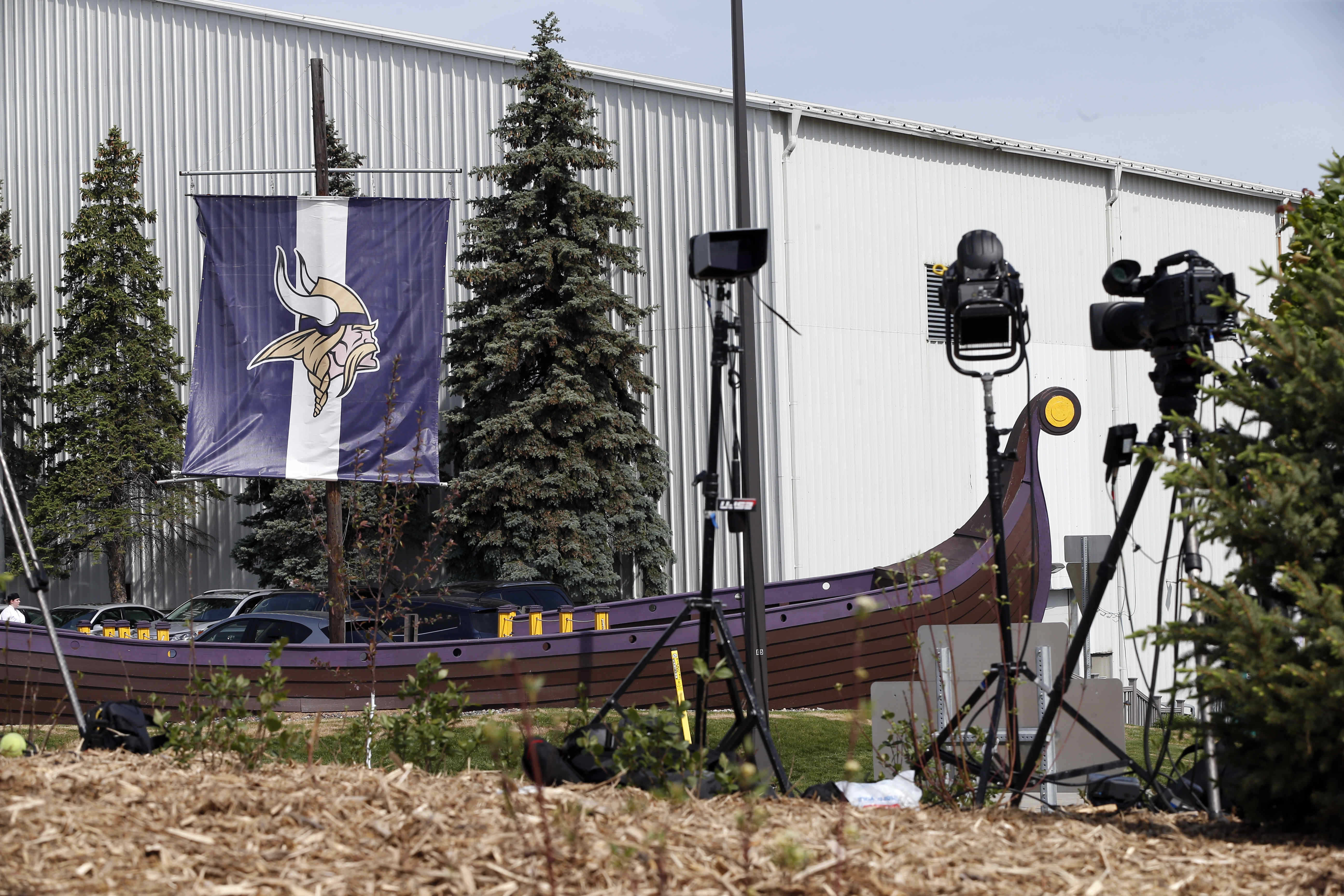 FILE - In this June 2, 2015 file photo, the Minnesota Vikings logo is attached to the mast of the Vikings'  ship outside the team's NFL football headquarters in Eden Prairie, Minn.The Vikings, already bound for a glitzy new stadium, could have another mov