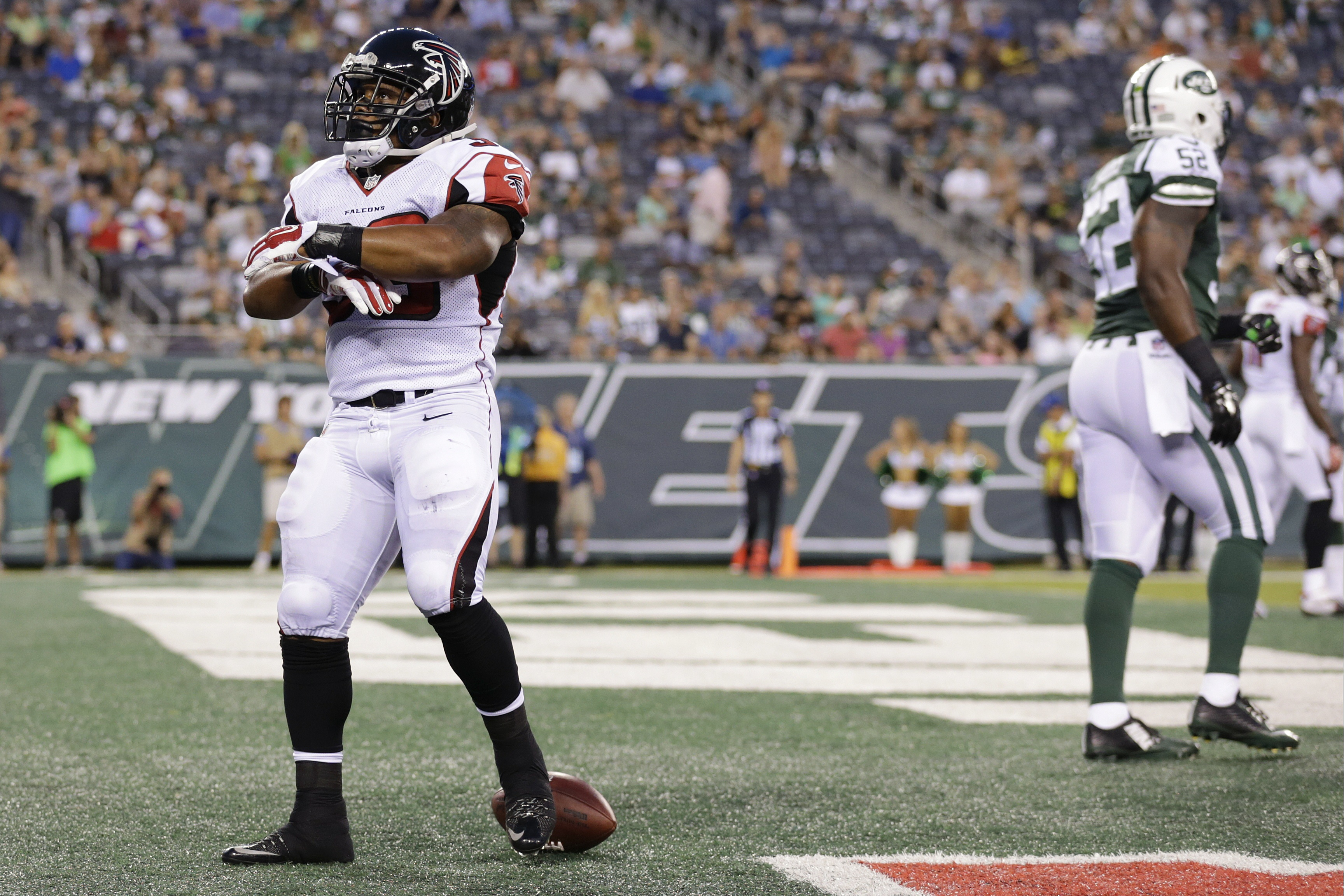 Atlanta Falcons running back Terron Ward (33) celebrates after rushing for a touchdown as New York Jets' David Harris (52) walks away during the first half of a preseason NFL football game Friday, Aug. 21, 2015, in East Rutherford, N.J. (AP Photo/Adam Hun