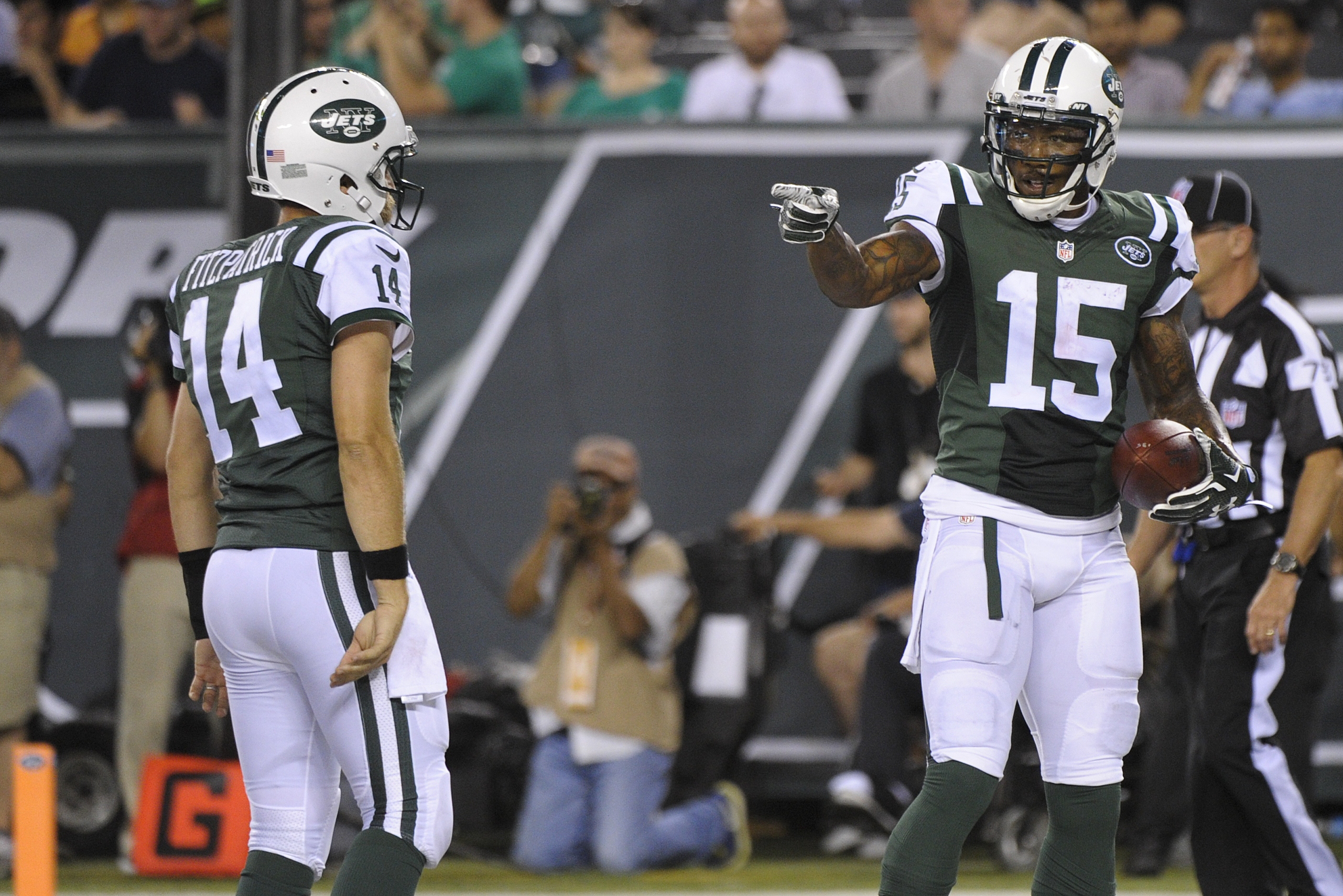 New York Jets wide receiver Brandon Marshall (15) gestures to quarterback Ryan Fitzpatrick (14) after they teamed up on a 2-point conversion during the first half of a preseason NFL football game against the Atlanta Falcons on Friday, Aug. 21, 2015, in Ea