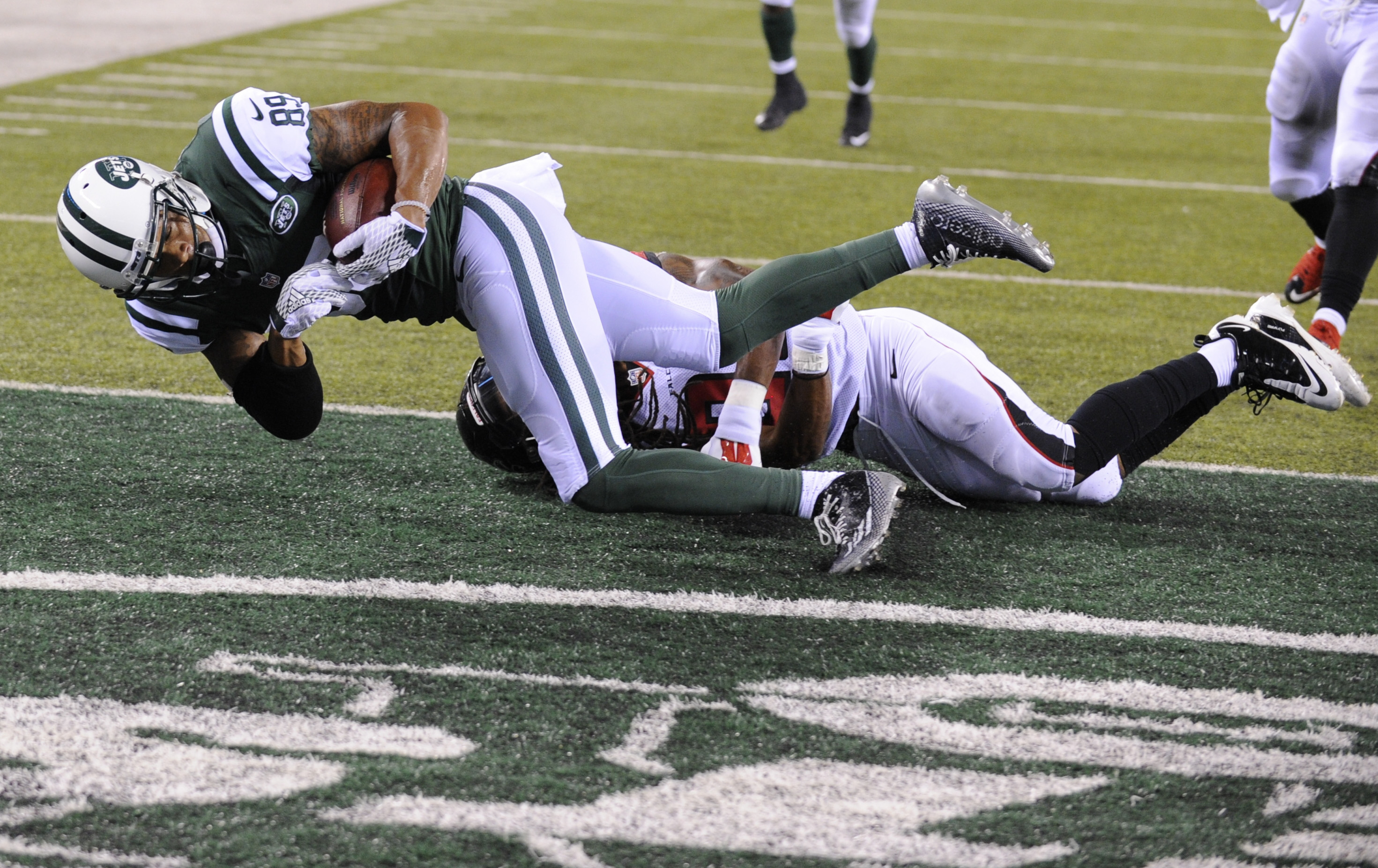 New York Jets wide receiver DeVier Posey (89) catches a pass for a touchdown as Atlanta Falcons' Dezmen Southward (22) defends during the second half of a preseason NFL football game Friday, Aug. 21, 2015, in East Rutherford, N.J. (AP Photo/Bill Kostroun)