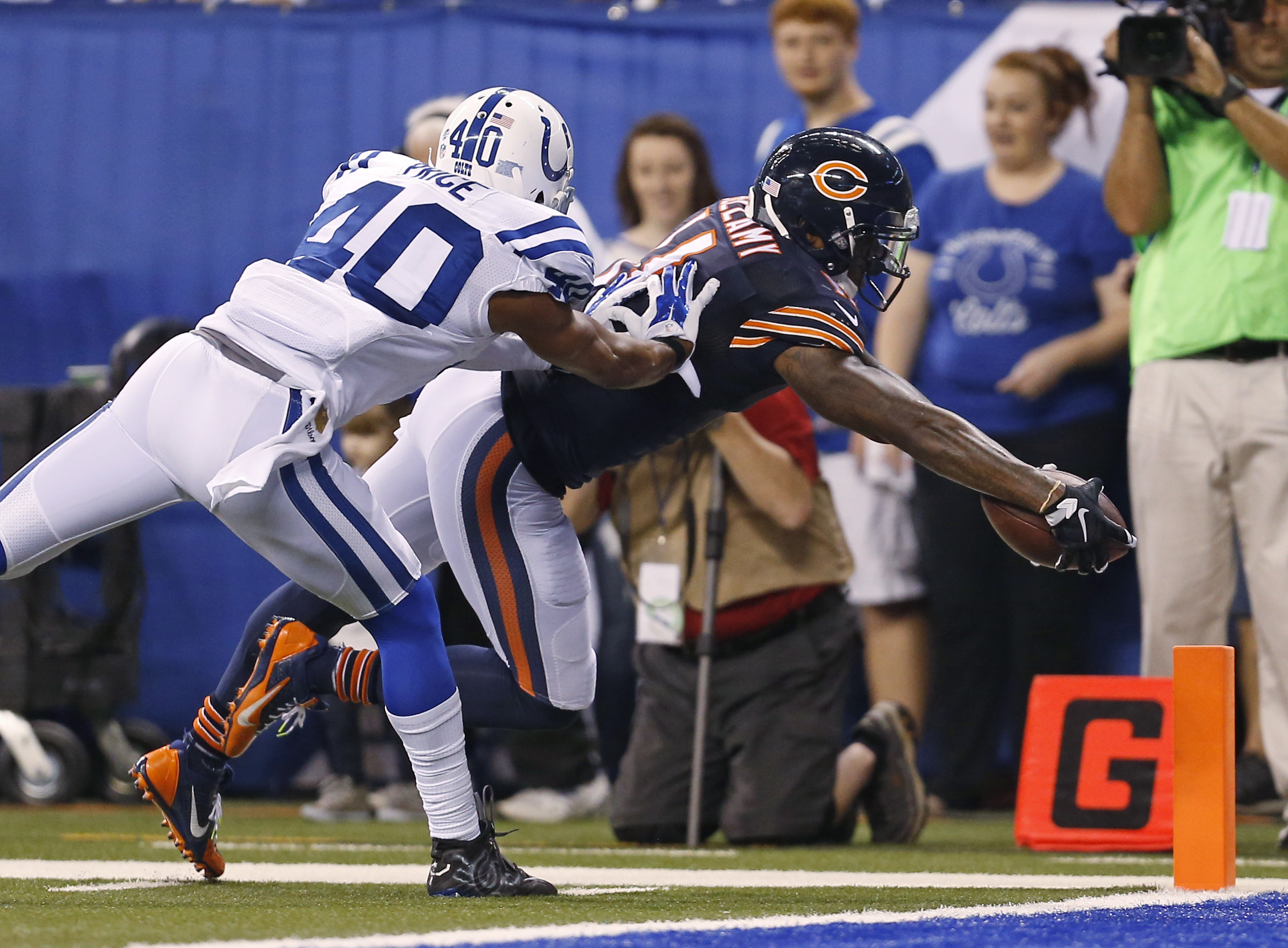 Chicago Bears wide receiver Josh Bellamy (11) dives in for a touchdown in front of Indianapolis Colts cornerback Sheldon Price (40) during the second half of an NFL preseason football game in Indianapolis, Saturday, Aug. 22, 2015. (AP Photo/Sam Riche)