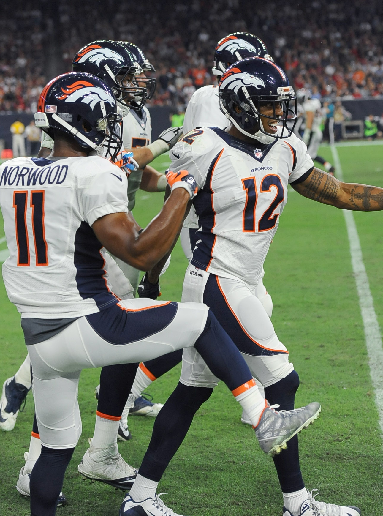 Denver Broncos' Andre Caldwell (12) celebrates with teammates after he scored a touchdown against the Houston Texans during the first half of an NFL preseason football game, Saturday, Aug. 22, 2015, in Houston. (AP Photo/George Bridges)