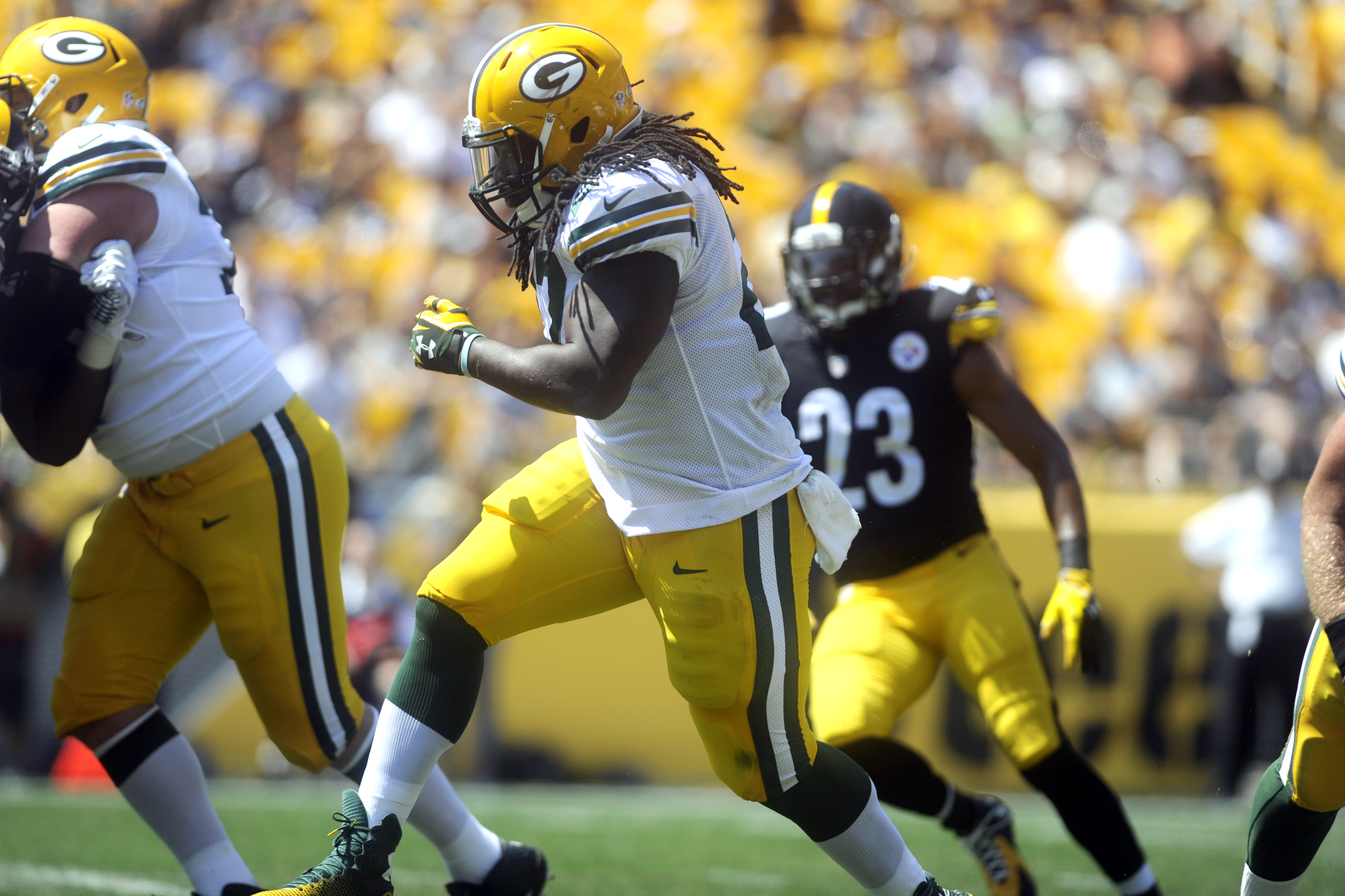 CORRECTS DAY OF THE WEEK TO SUNDAY - Green Bay Packers running back Eddie Lacy (27) runs past Pittsburgh Steelers free safety Mike Mitchell (23) for a touchdown in the first quarter of the pre-seaon NFL football game, Sunday, Aug. 23, 2014 in Pittsburgh.