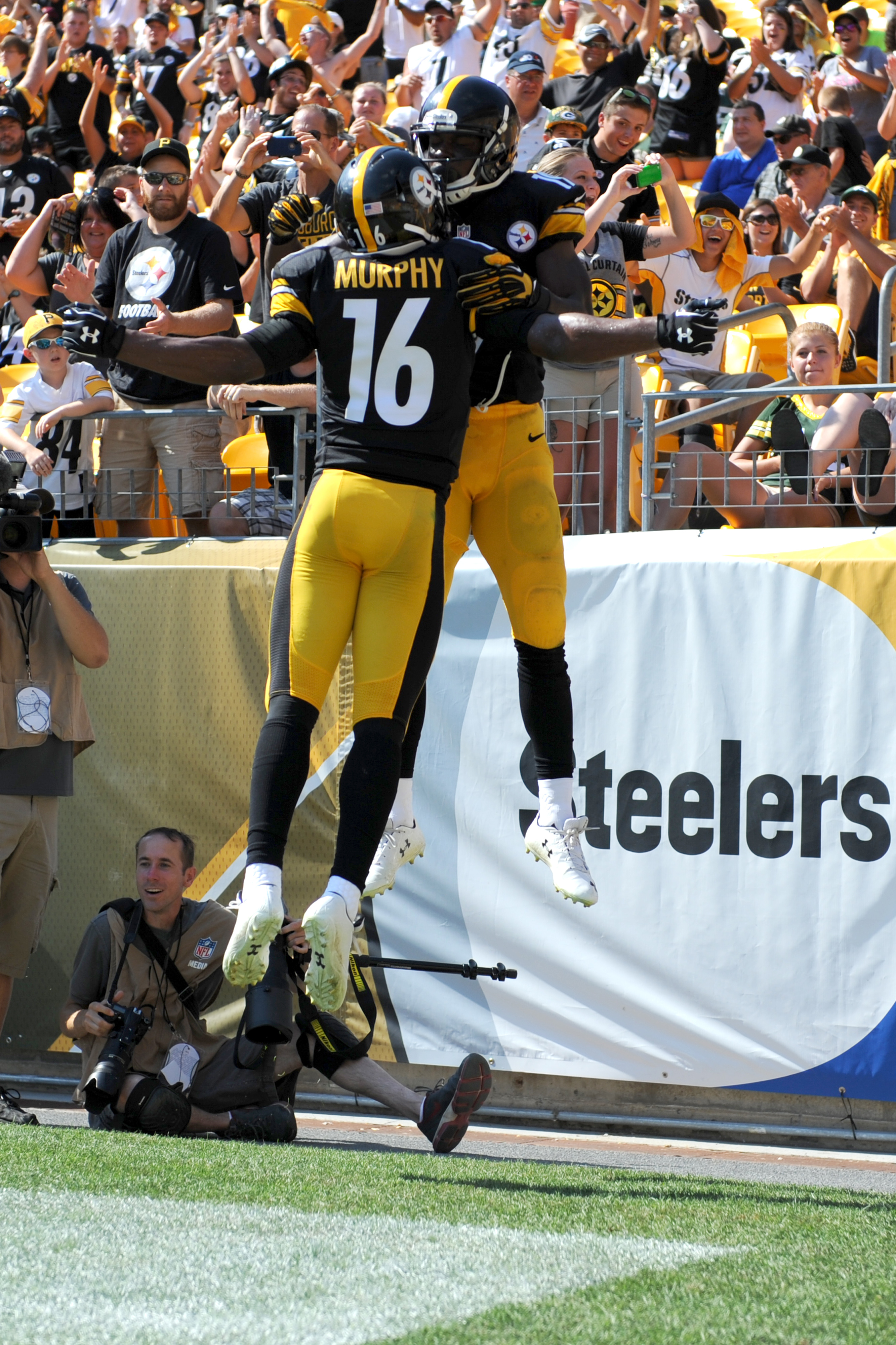 Pittsburgh Steelers wide receiver Shakim Phillips, rear, celebrates with Tyler Murphy after making a touchdown catch during the fourth quarter of the NFL preseason football game against the Green Bay Packers, Sunday, Aug. 23, 2015, in Pittsburgh. (AP Phot