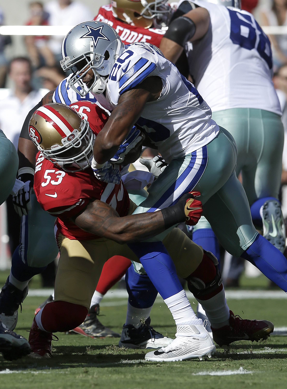San Francisco 49ers linebacker NaVorro Bowman (53) tackles Dallas Cowboys running back Darren McFadden (20) during the first half of an NFL preseason football game in Santa Clara, Calif., Sunday, Aug. 23, 2015. (AP Photo/Jeff Chiu)