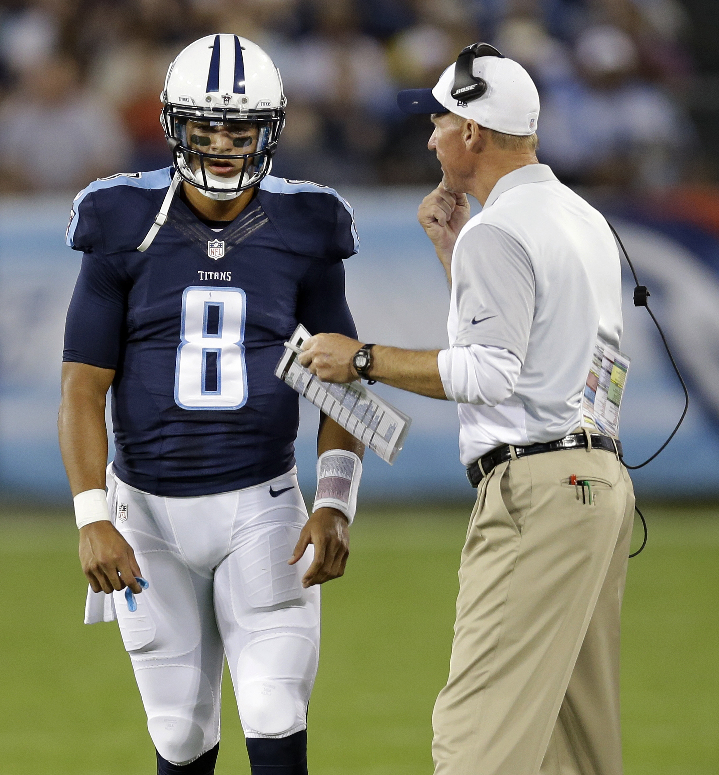 Tennessee Titans coach Ken Whisenhunt talks with quarterback Marcus Mariota during the first half of a preseason NFL football game against the St. Louis Rams on Sunday, Aug. 23, 2015, in Nashville, Tenn. (AP Photo/James Kenney)
