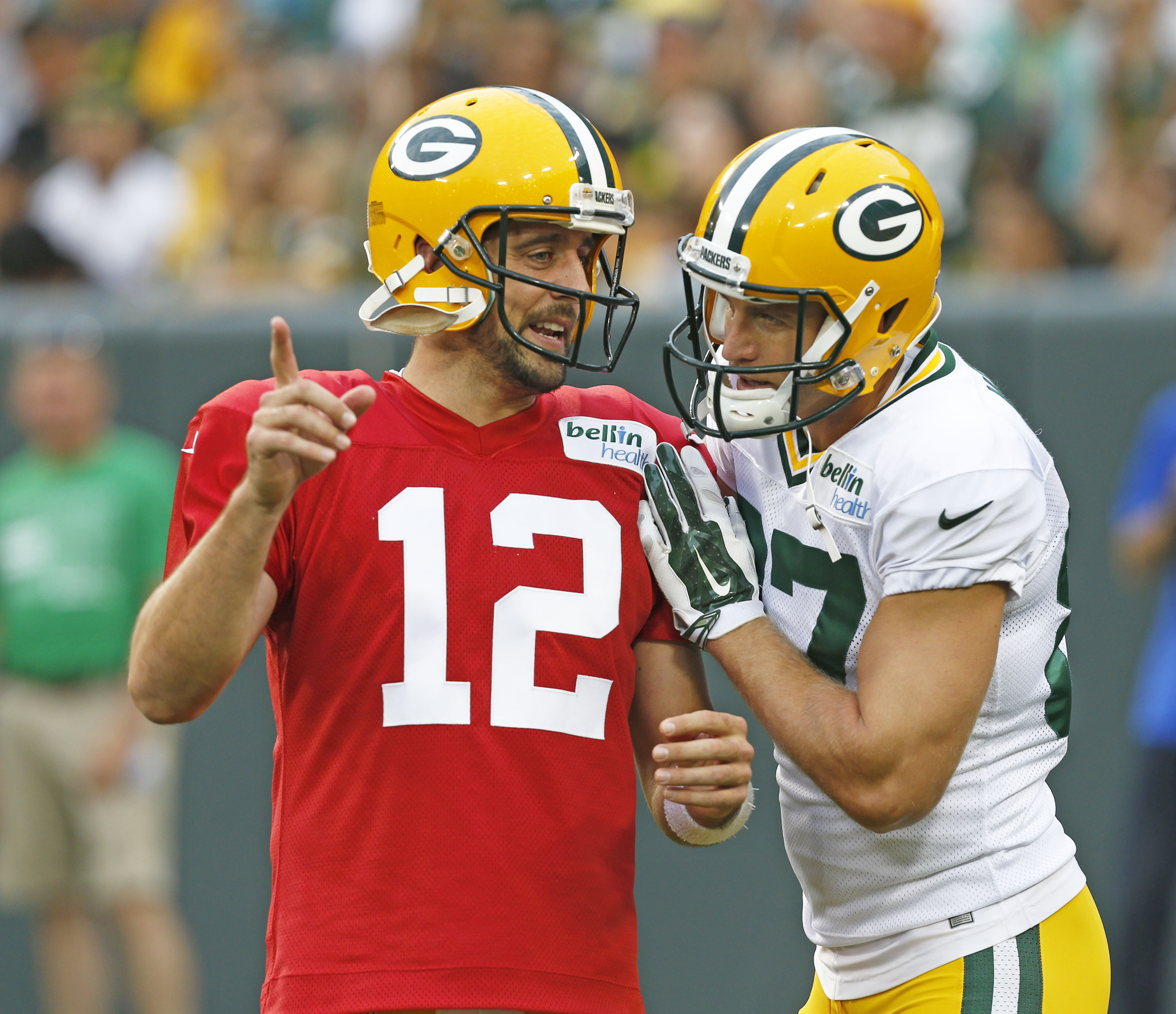 FILE - In this Aug. 8, 2015, file photo, Green Bay Packers' Aaron Rodgers, left, and Jordy Nelson talk during the Green Bay Packers Family Fun Night NFL football training camp practice in Green Bay, Wis. Few receivers are as important to their teams as Ne
