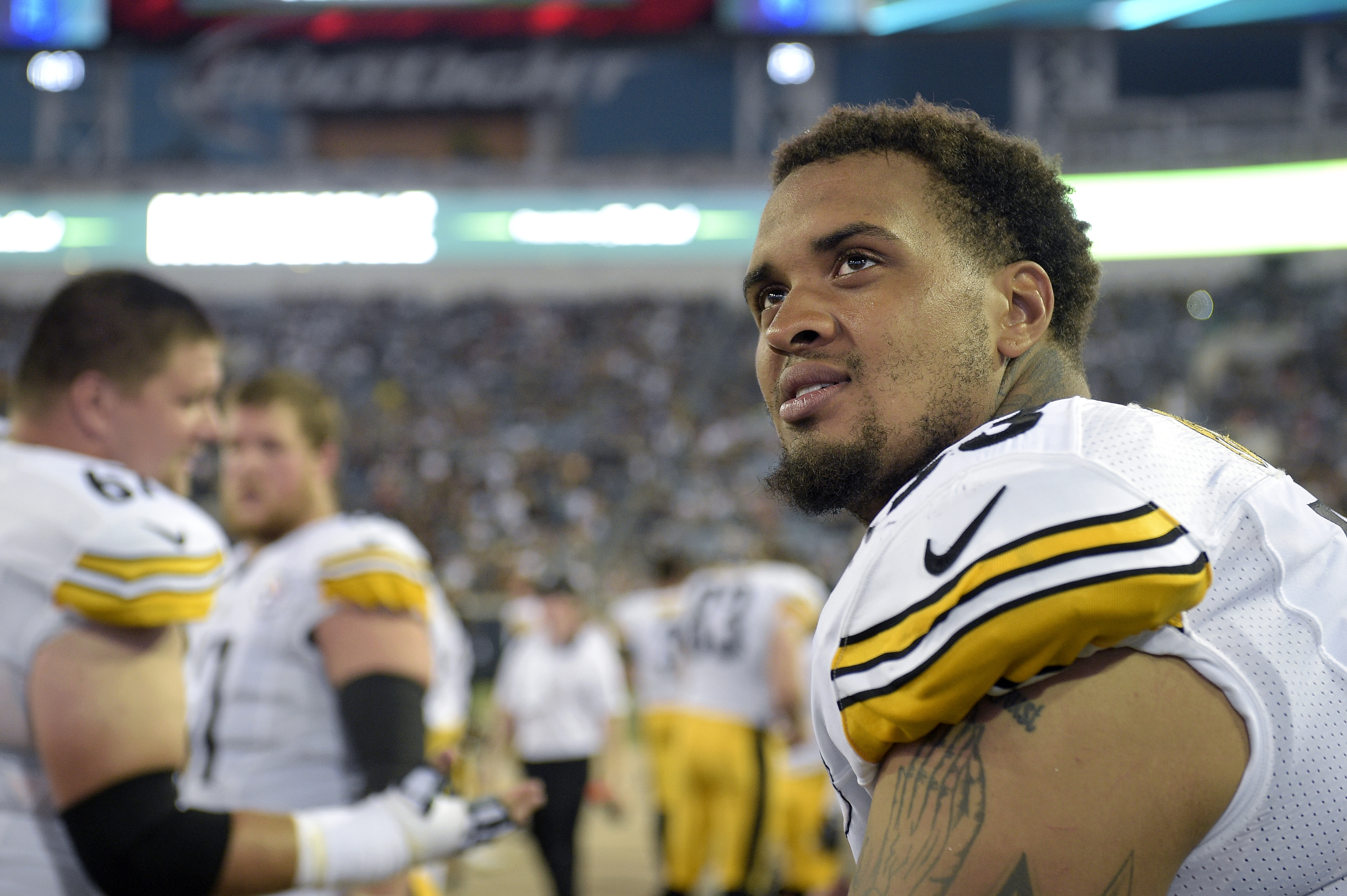 FILE - In this Aug. 14, 2015, file photo, Pittsburgh Steelers center Maurkice Pouncey, right, watches from the bench during the first half of an NFL preseason football game against the Jacksonville Jaguars in Jacksonville, Fla.. (AP Photo/Phelan M. Ebenha