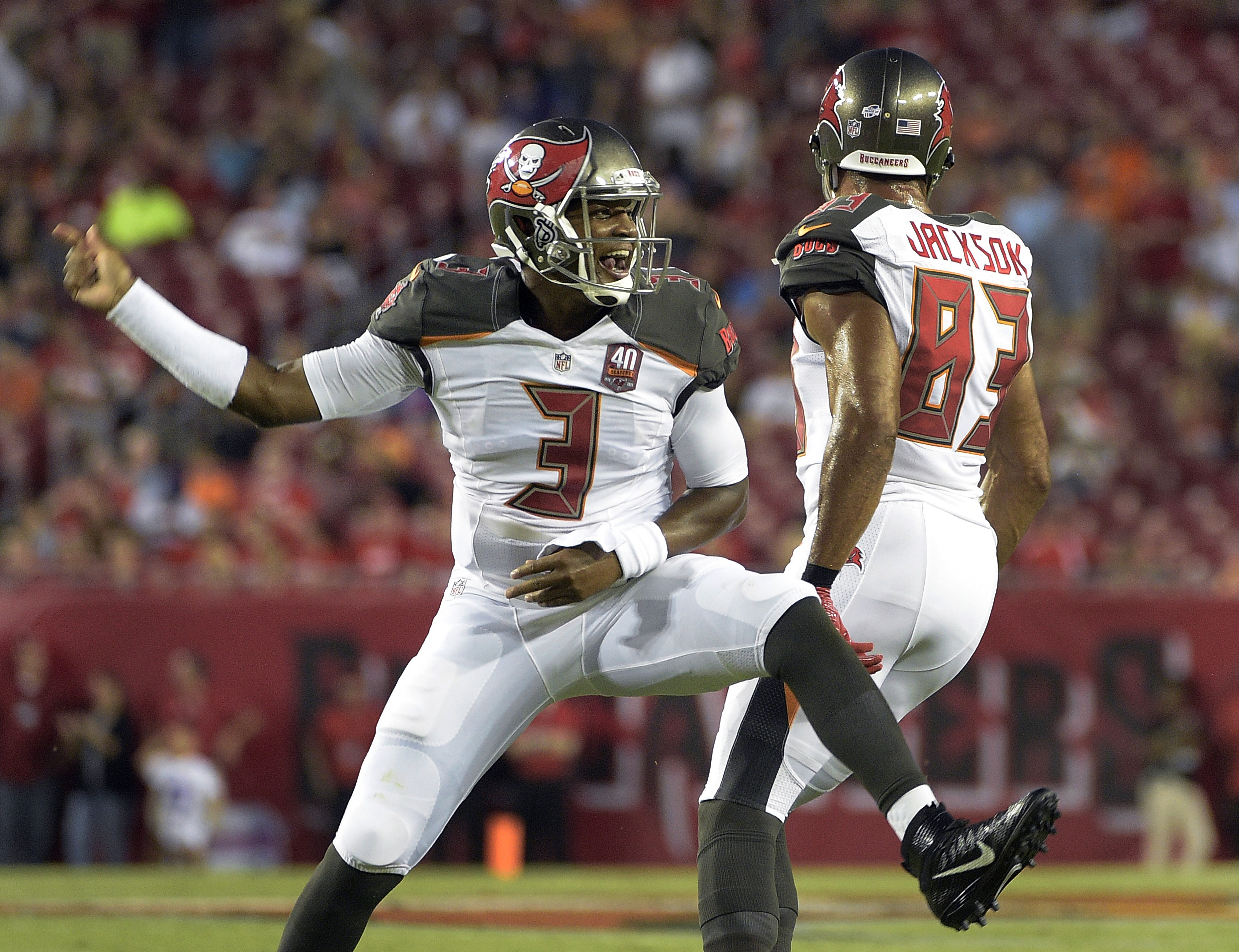 Tampa Bay Buccaneers quarterback Jameis Winston (3) celebrates with wide receiver Vincent Jackson (83) after Winston scored a touchdown against the Cincinnati Bengals during the first quarter of an NFL preseason football game Monday, Aug. 24, 2015, in Tam