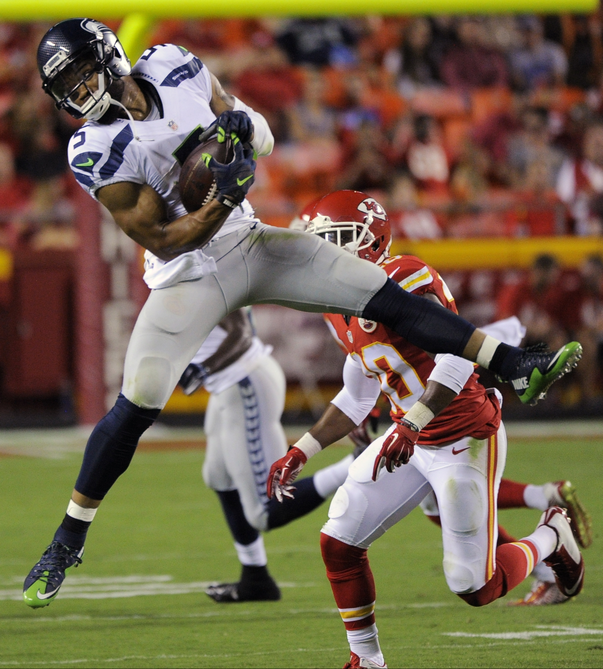 FILE - In this Aug. 21, 2015, file photo, Seattle Seahawks quarterback B.J. Daniels (5) makes a catch in front of Kansas City Chiefs cornerback Steven Nelson (20) during the second half of a preseason NFL football game at Arrowhead Stadium in Kansas City,