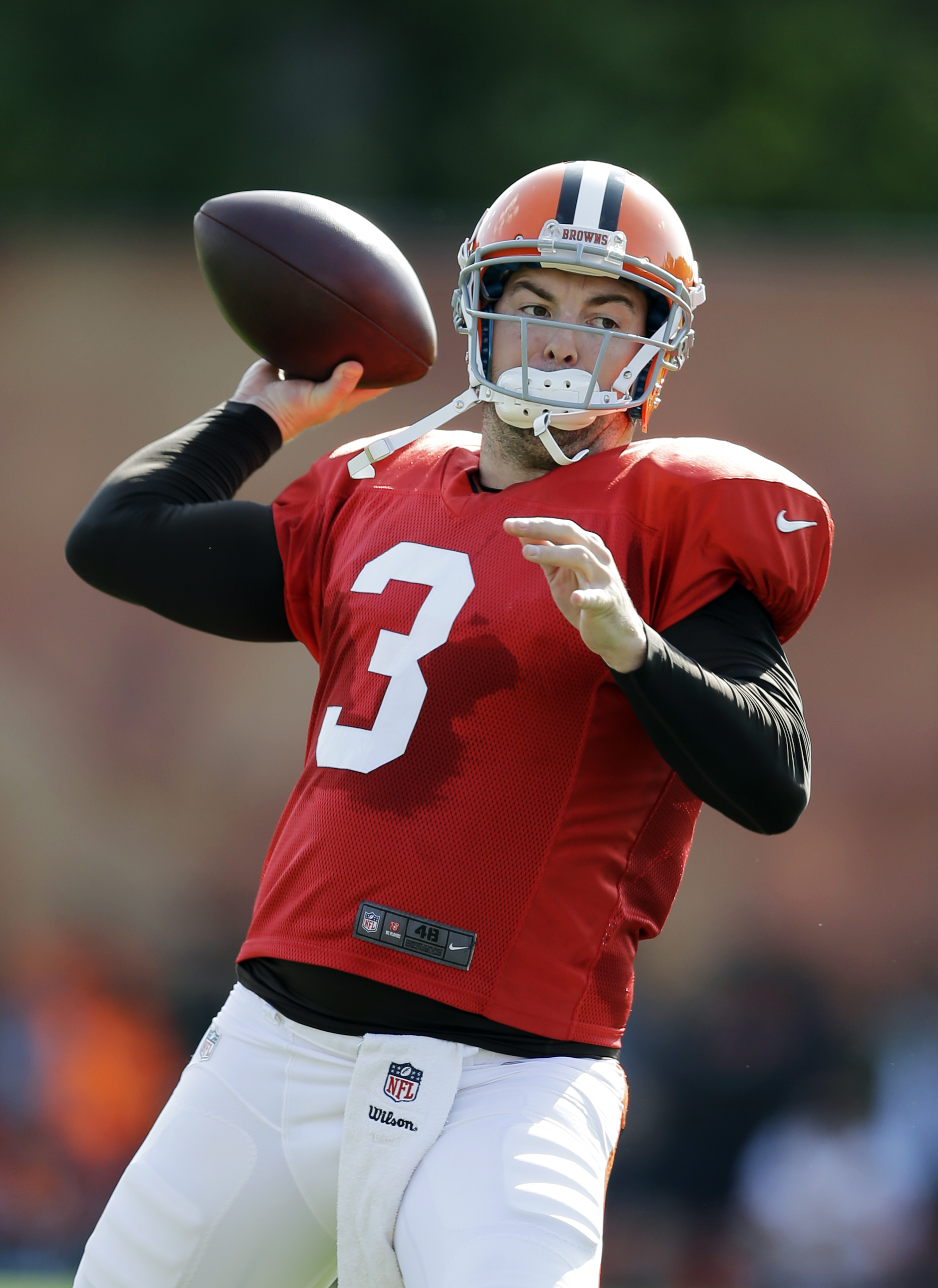FILE - In this Aug. 19, 2014, file photo, Cleveland Browns quarterback Rex Grossman passes during practice at NFL football training camp in Berea, Ohio. The Atlanta Falcons have signed Rex Grossman to compete for the backup quarterback job behind Matt Rya