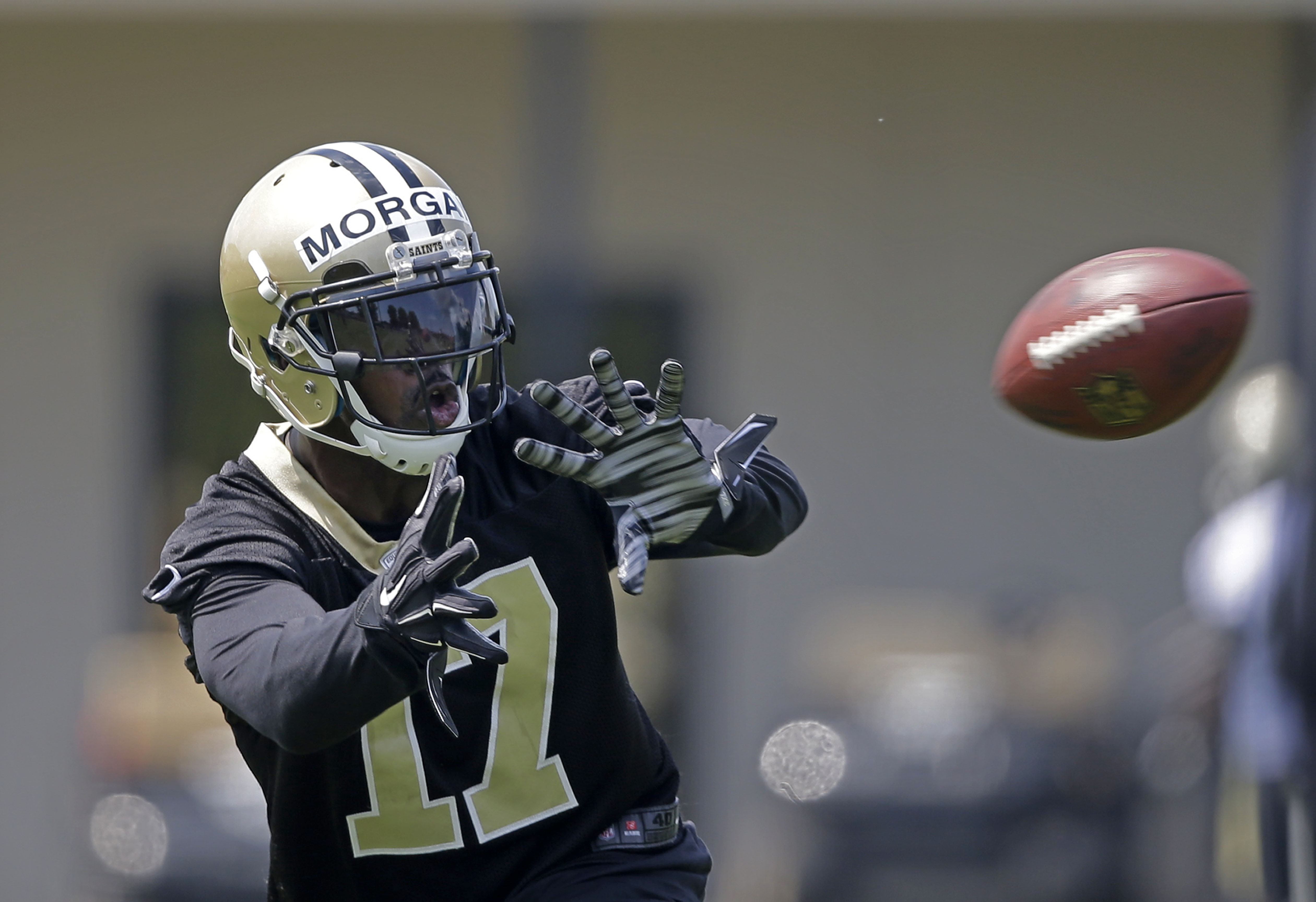 FILE - In this file photo taken June 4, 2015, New Orleans Saints wide receiver Josh Morgan (17) works out during an NFL football organized team activity in Metairie, La. While veteran receiver Morgan is by no means assured of a roster spot in New Orleans,