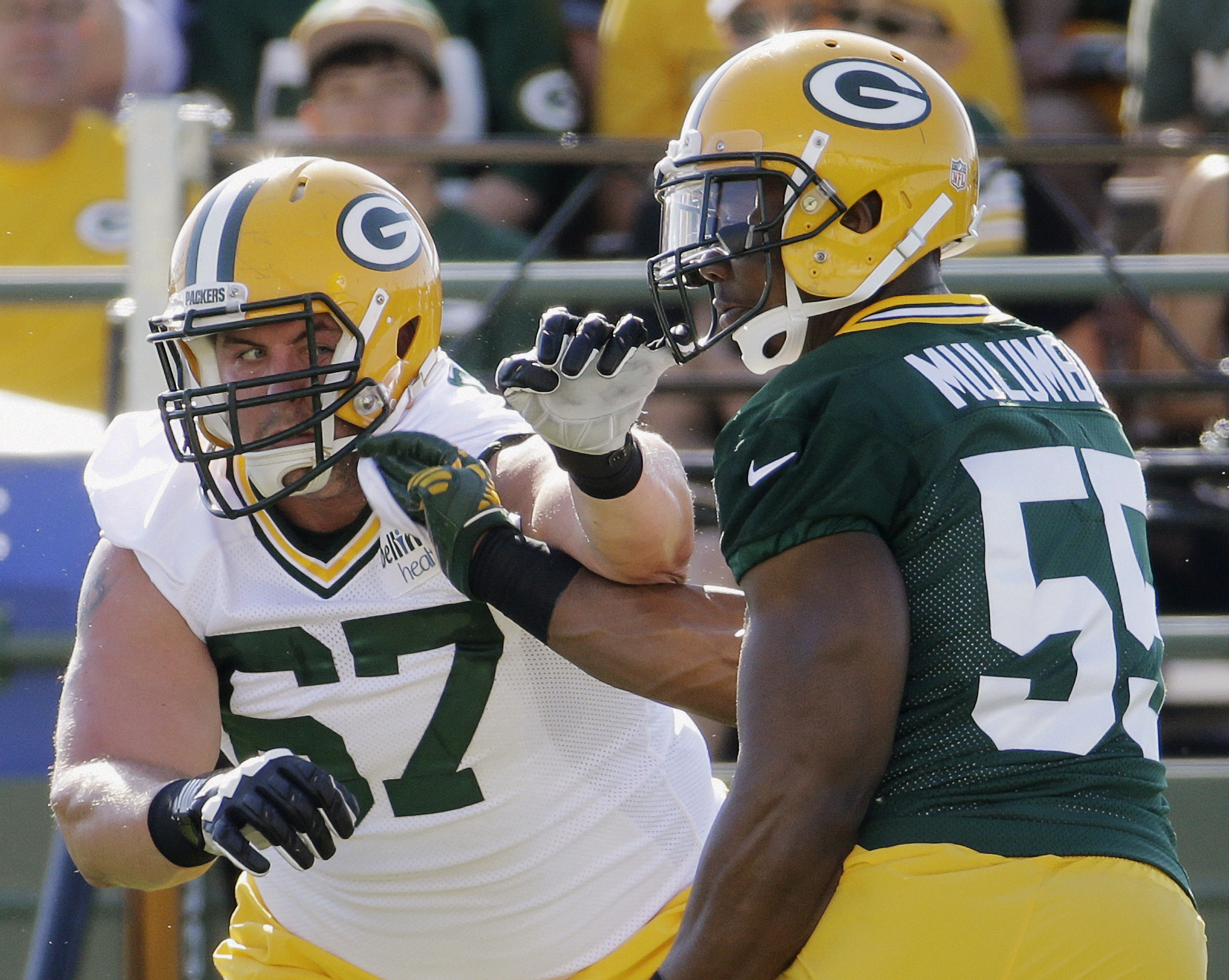 FILE - In this July 30, 2015, file photo, Green Bay Packers' Don Barclay (67) tries to block Andy Mulumba during NFL football training camp in Green Bay, Wis. Barclay has been getting first-team reps at left tackle with David Bakhtiari out. But Barclay, w