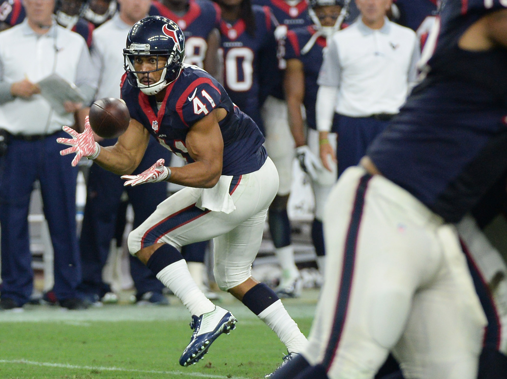 FILE - In this Aug. 22, 2015, file photo, Houston Texans' Jonathan Grimes (41) makes a catch against the Denver Broncos during the first half of an NFL preseason football gamein Houston. Grimes got an NFL pink slip four times before finally hanging on wit