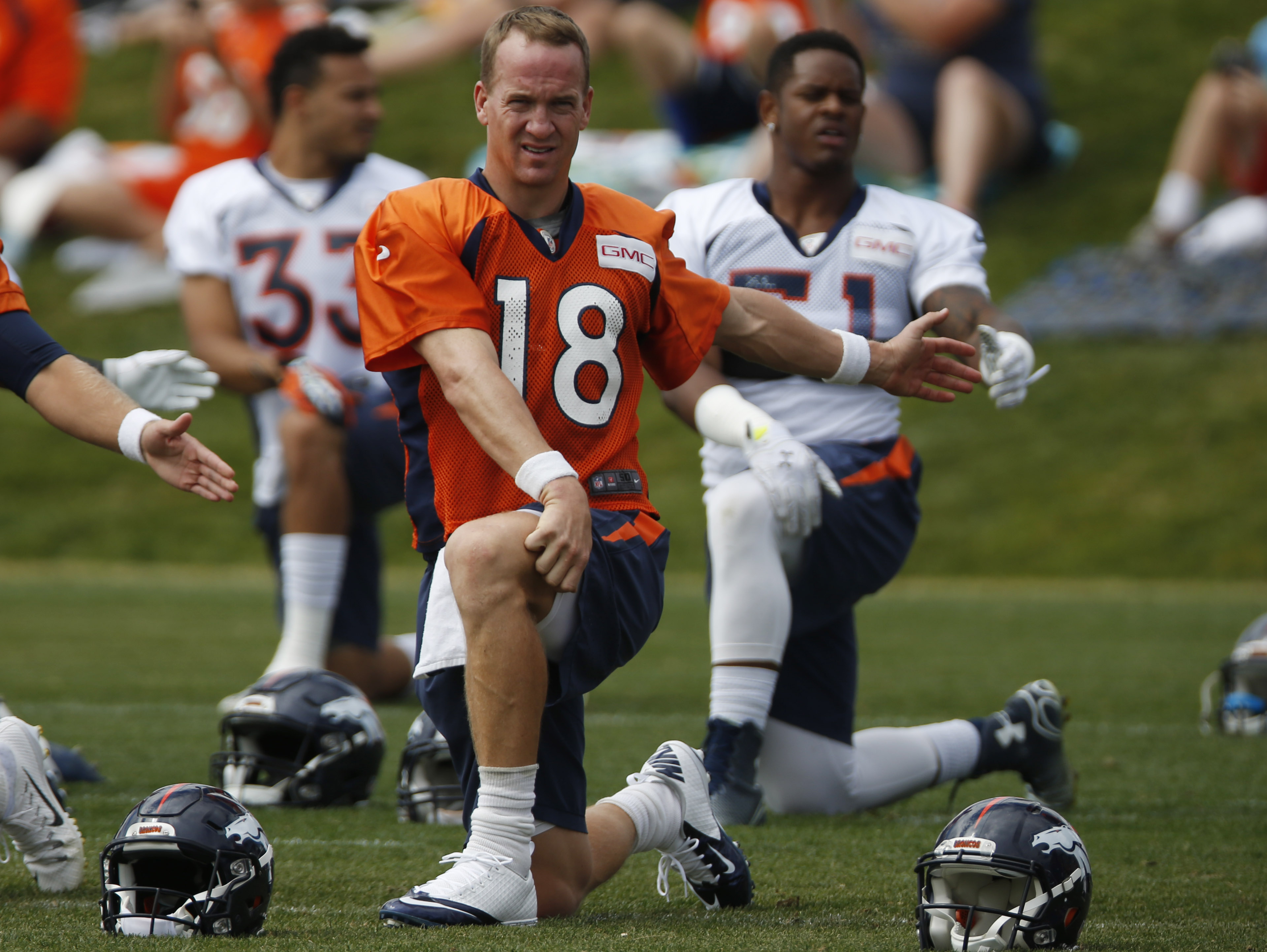 Denver Broncos quarterback Peyton Manning stretches before facing the San Francisco 49ers in an NFL football scrimmage at the Broncos' headquarters Thursday, Aug. 27, 2015, in Englewood, Colo. (AP Photo/David Zalubowski)