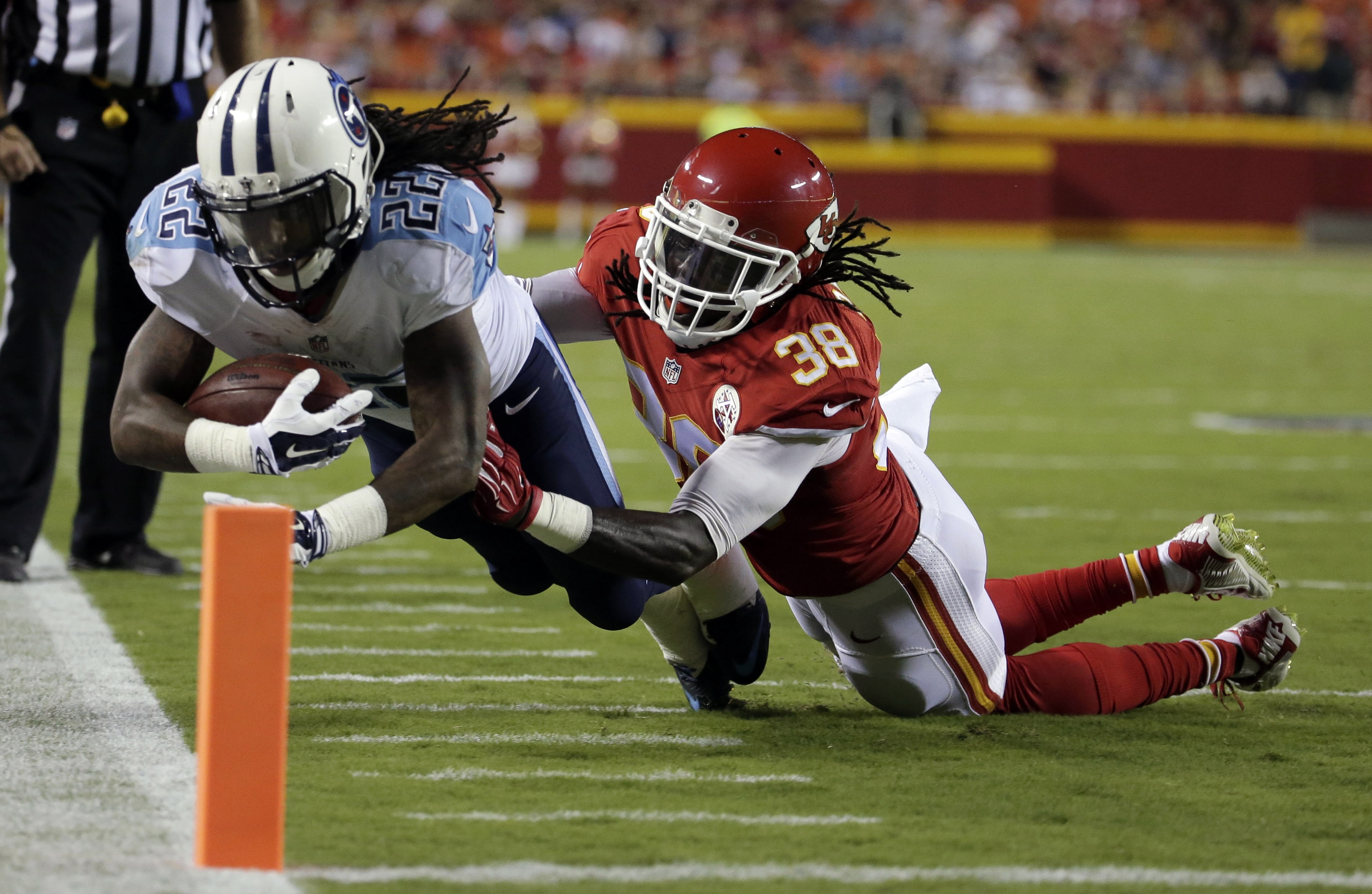 Tennessee Titans running back Dexter McCluster (22) is pushed out of bounds by Kansas City Chiefs defensive back Ron Parker (38) during the first half of a preseason NFL football game at Arrowhead Stadium in Kansas City, Mo., Friday, Aug. 28, 2015. (AP Ph