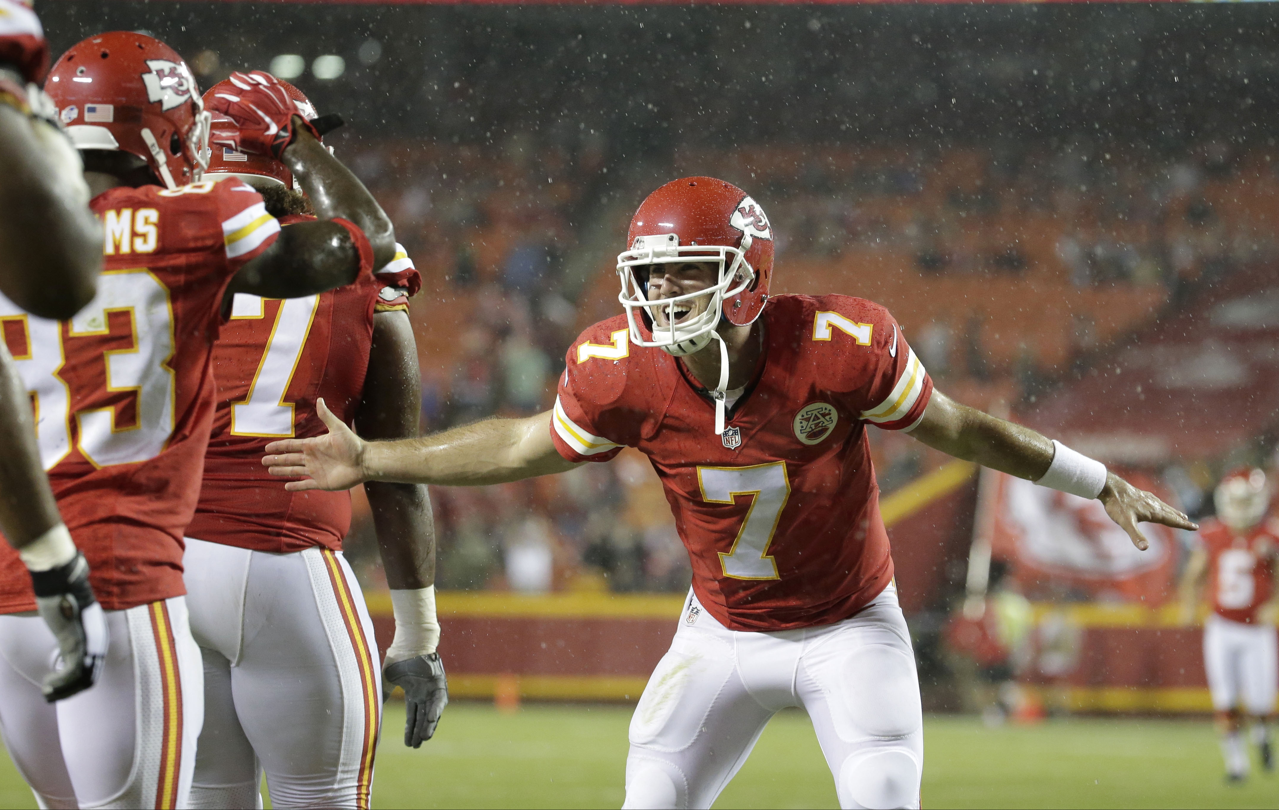 Kansas City Chiefs quarterback Aaron Murray (7) celebrates with teammates during the second half of a preseason NFL football game against the Tennessee Titans at Arrowhead Stadium in Kansas City, Mo., Friday, Aug. 28, 2015. (AP Photo/Charlie Riedel)