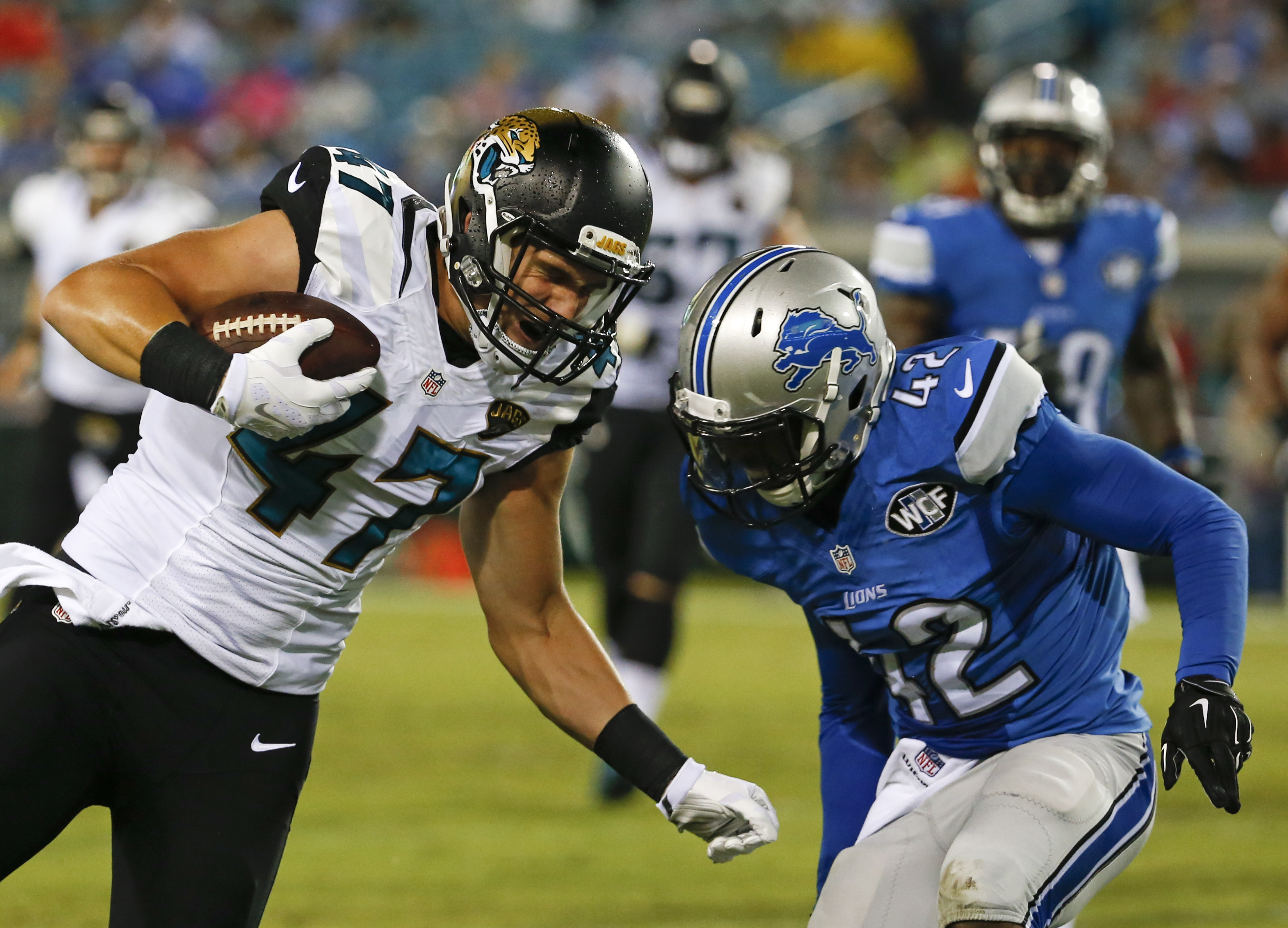 Jacksonville Jaguars tight end Connor Hamlett (47) runs against Detroit Lions strong safety Isa Abdul-Quddus (42) during the second half of an NFL preseason football game in Jacksonville, Fla., Friday, Aug. 28, 2015. (AP Photo/Stephen B. Morton)